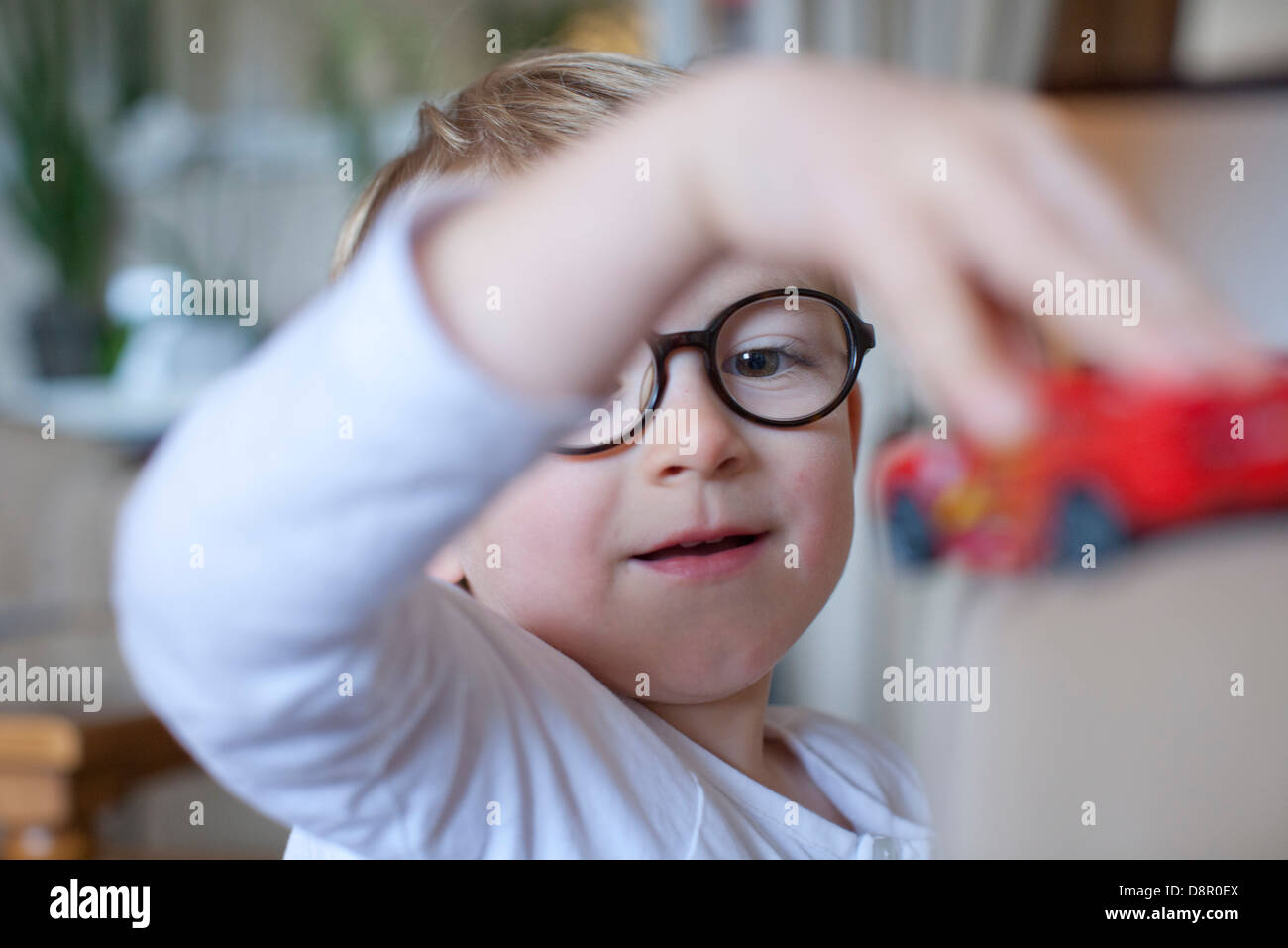 Little boy playing with toy Stock Photo