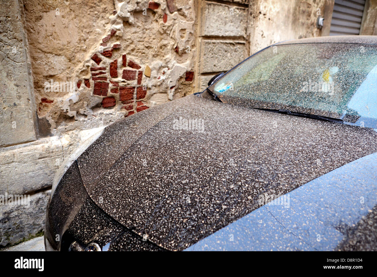 Volcanic ash from Etna falling in the rain get dirty cars, Syracuse, Sicily, Italy - Stock Image