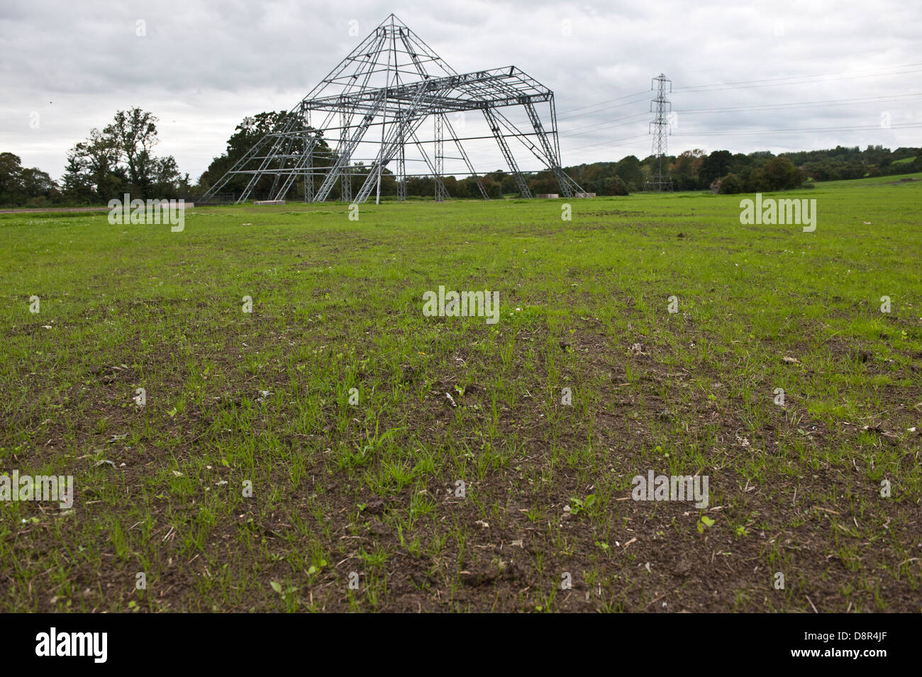 the scaffold structure of the main Pyramid Stage and newly planted grass seedlings views of Worthy Farm , Pilton, - Stock Image