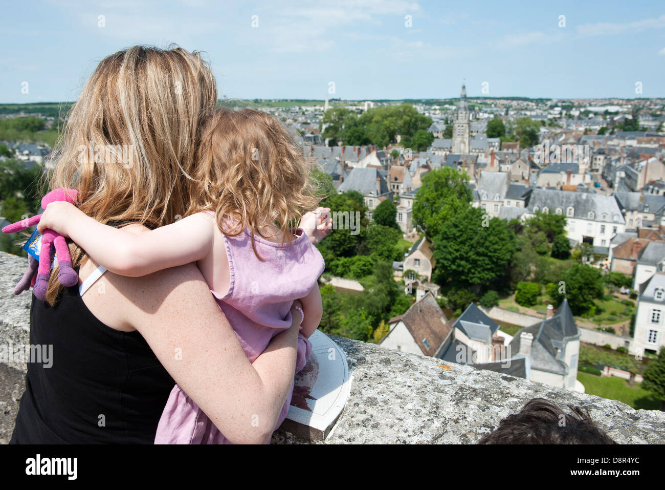 Mother and young daughter looking at view of Vendome, France - Stock Image