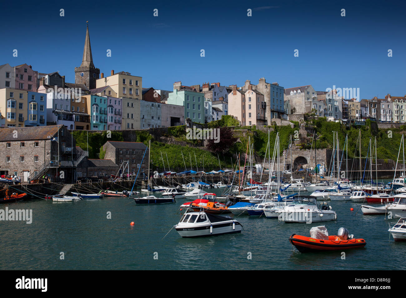 Boats moored in Tenby Harbour, Pembrokeshire, Wales - Stock Image