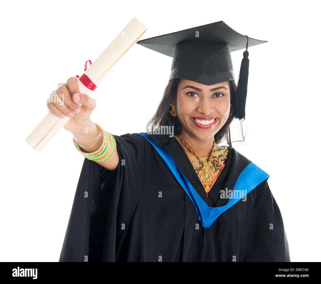 a9e54f1035 Happy Indian graduate student in graduation gown and cap showing her  diploma certificate. Portrait of
