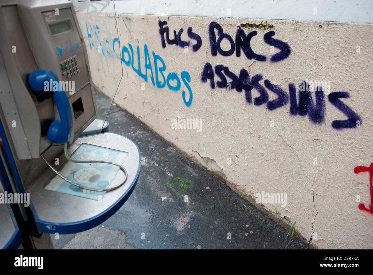 Graffiti painted on wall near payphone - Stock Image