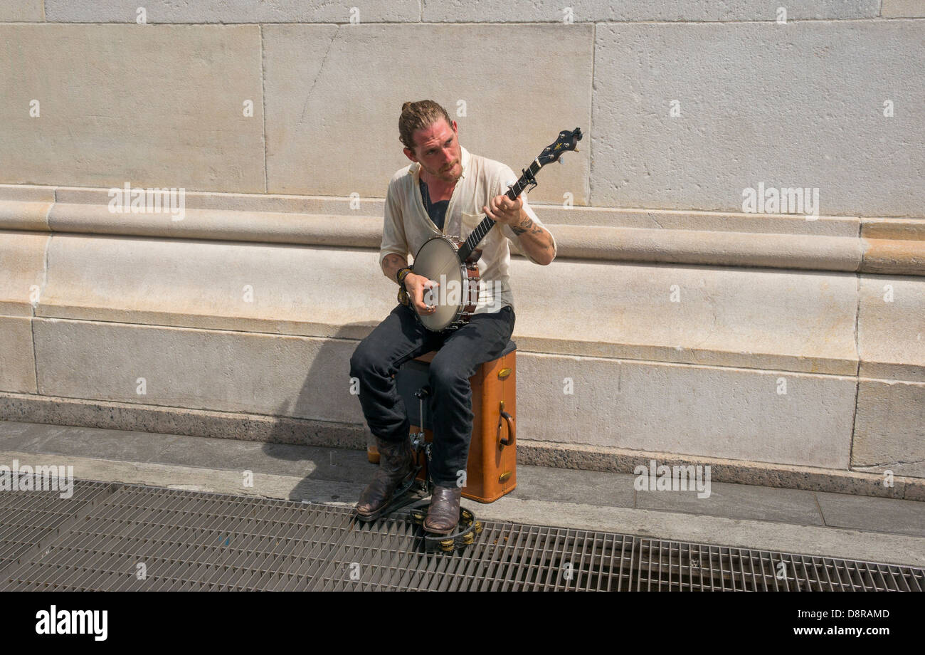 Five-string bluegrass banjo player busking in Greenwich Village in NYC - Stock Image
