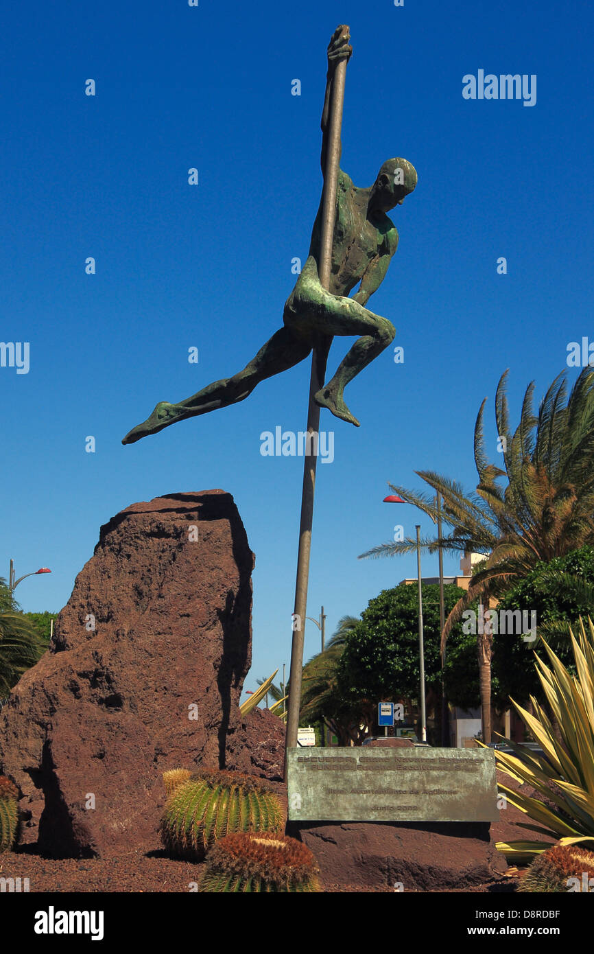 Sculpture of a pole vaulter, on a roundabout in Cruce de Arinaga, Gran Canaria. - Stock Image
