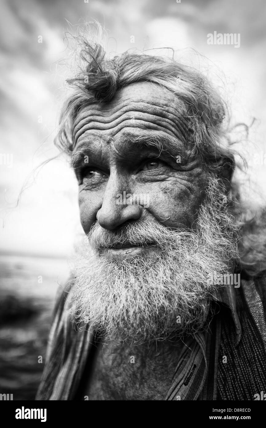 South African living legend, Ben Dekker, actor and philosopher. White bearded man with piercing eyes, black & - Stock Image