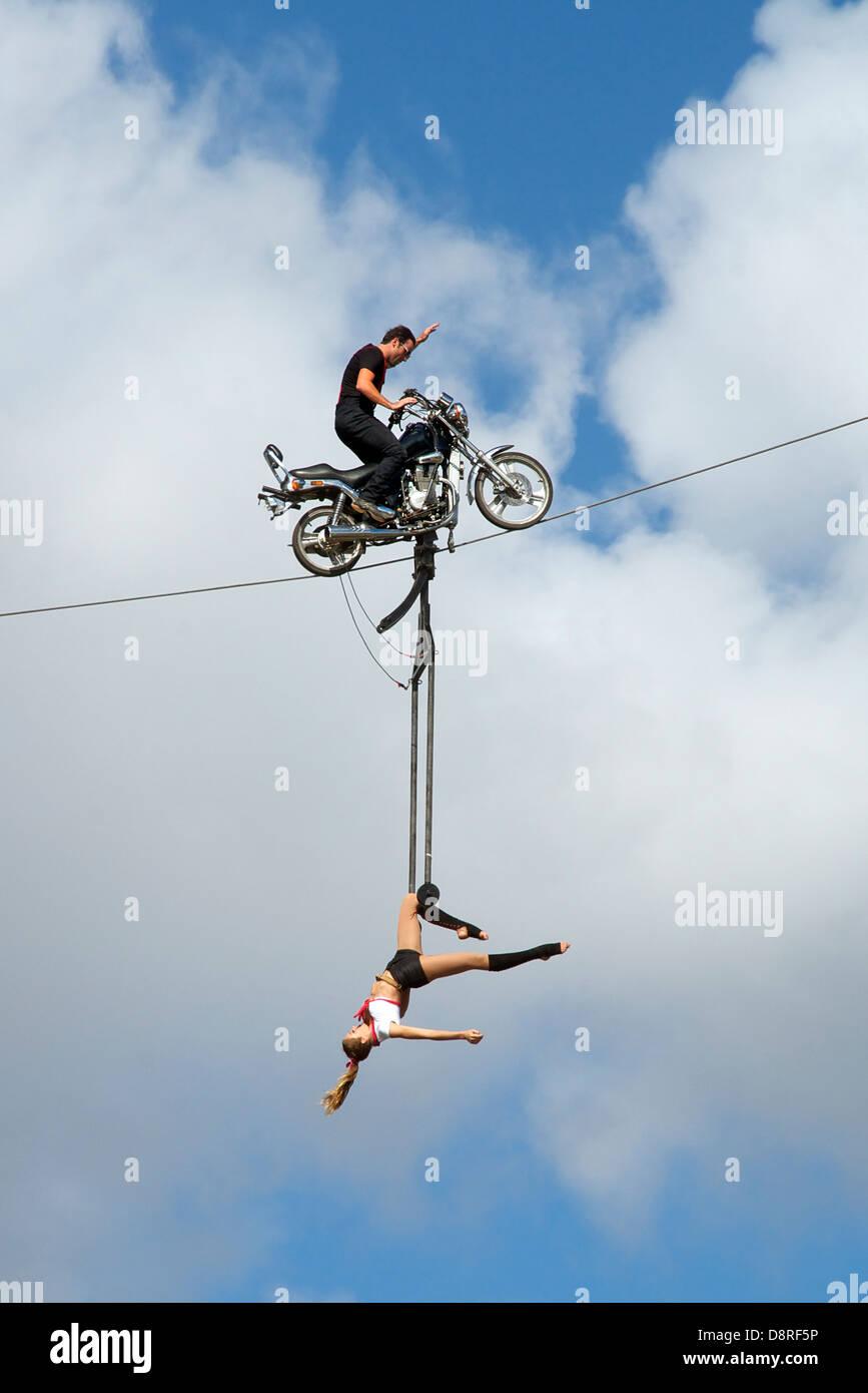 Motorbike stunt rider with girl Albert Park Melbourne Victoria Australia - Stock Image