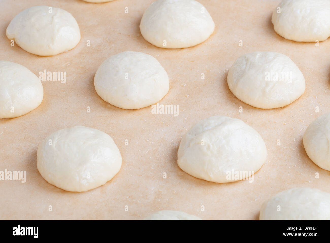 Small balls of fresh homemade pizza dough - Stock Image