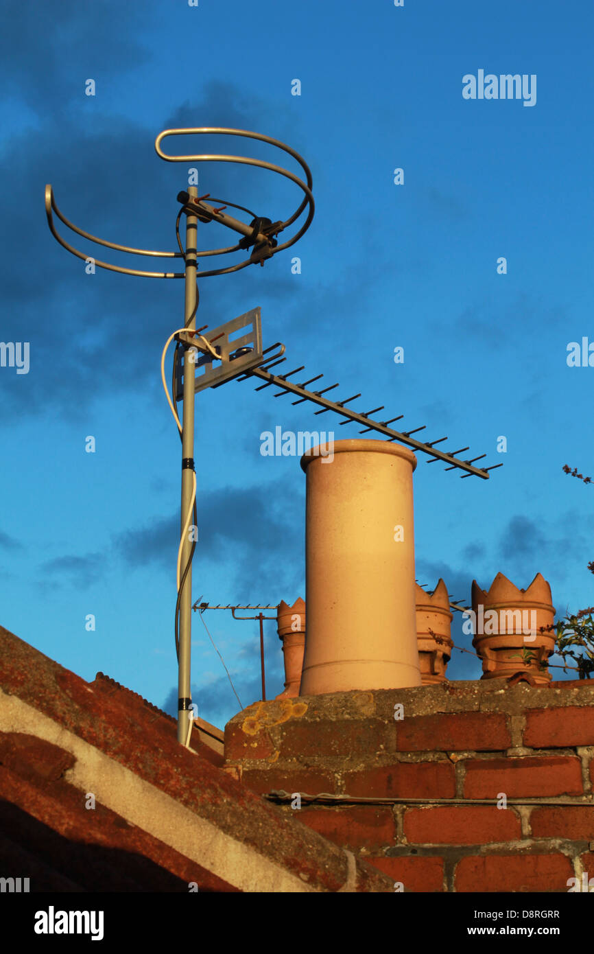 Television aerial and chimney pots - Stock Image