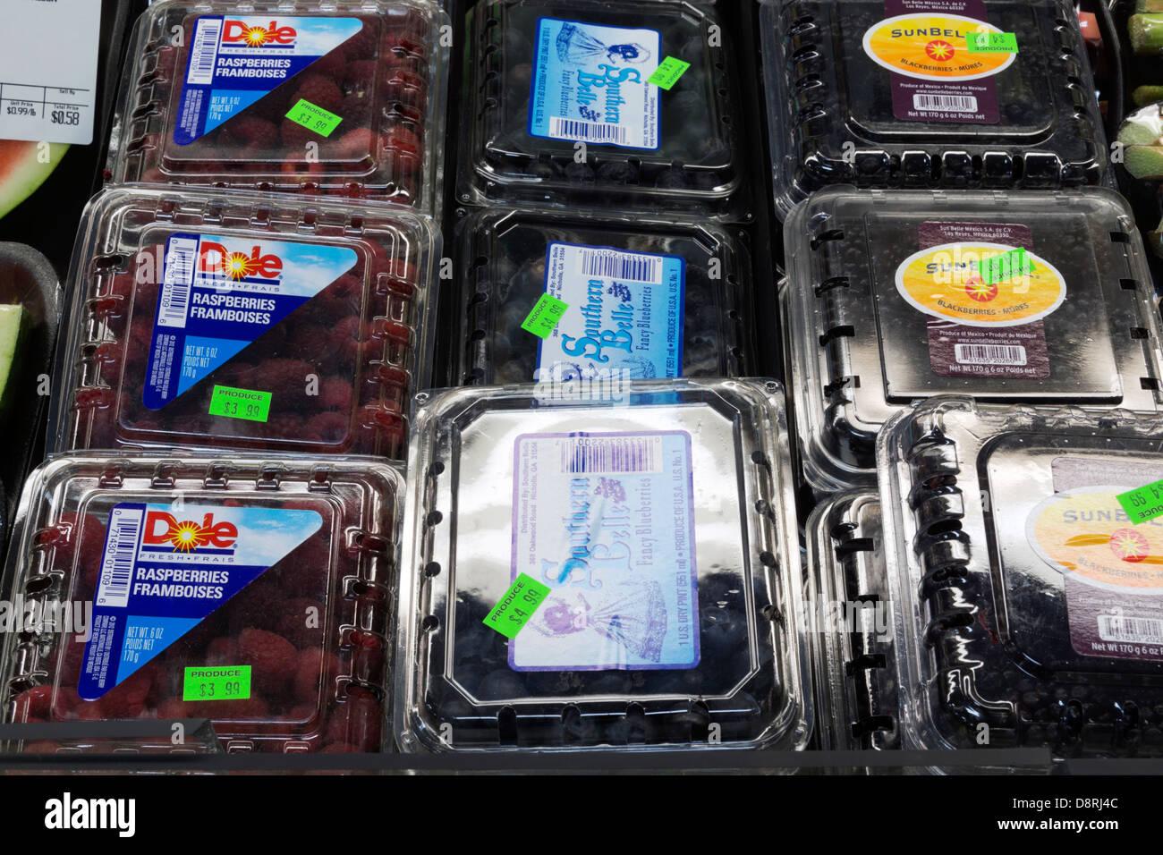 Raspberries Blueberries And Blackberries In A Grocery Store Display Case