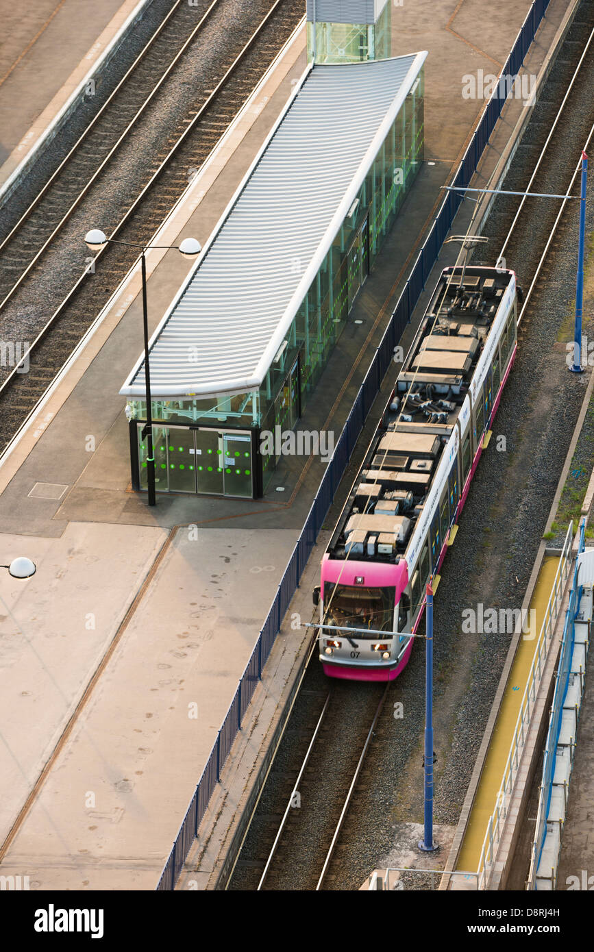 A tram puling in to Snow Hill station. Birmingham, West Midlands, England, UK Stock Photo