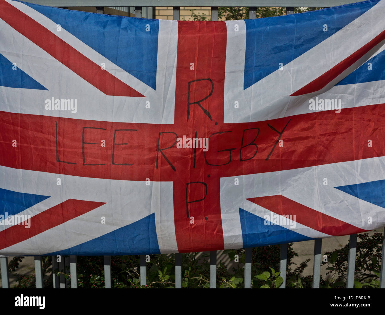 Union Jack with tribute to Drummer Lee Rigby, killed outside Woolwich Barracks in London on May 22 - Stock Image
