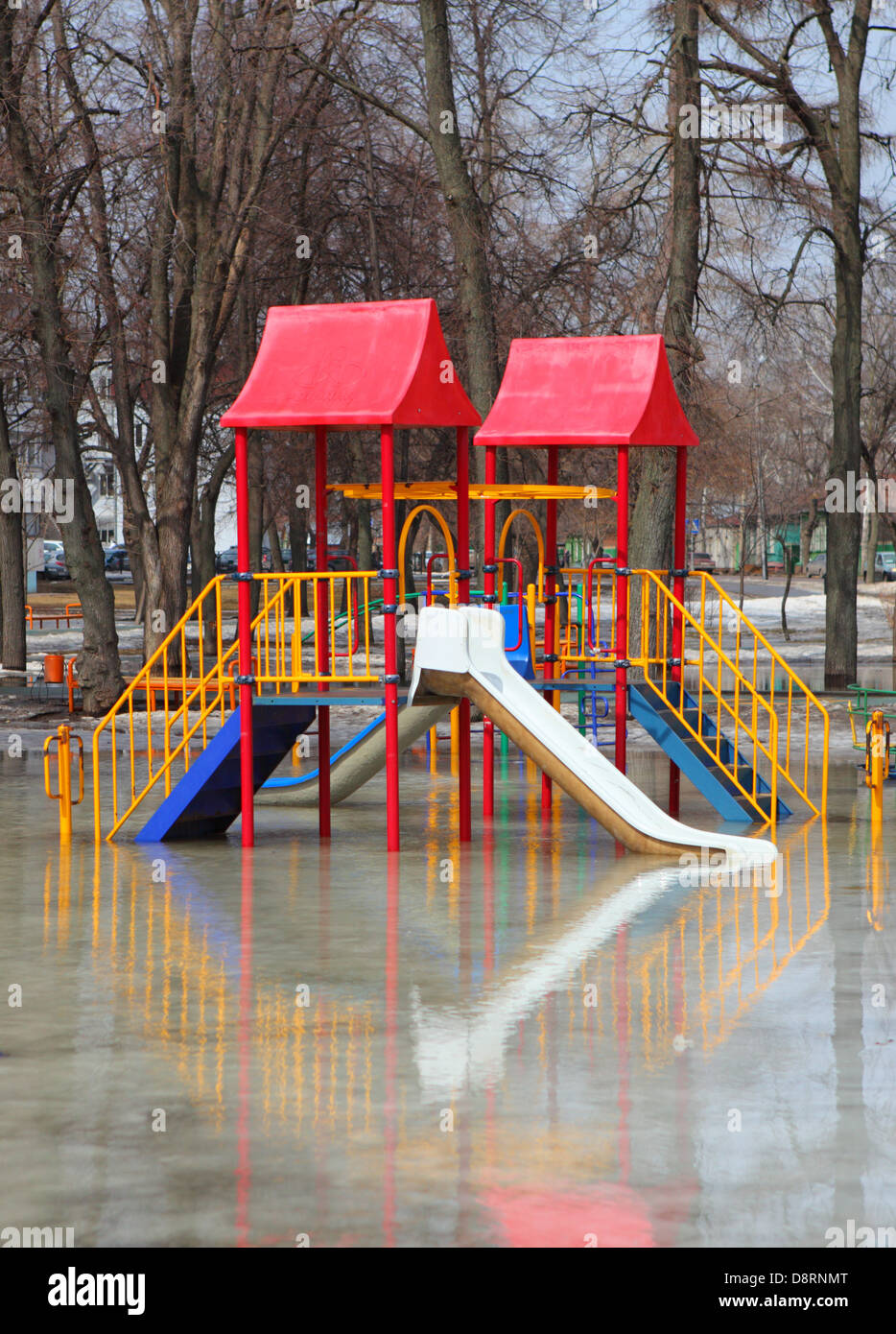 Flood Waters Empty the Childrens Playground Stock Photo