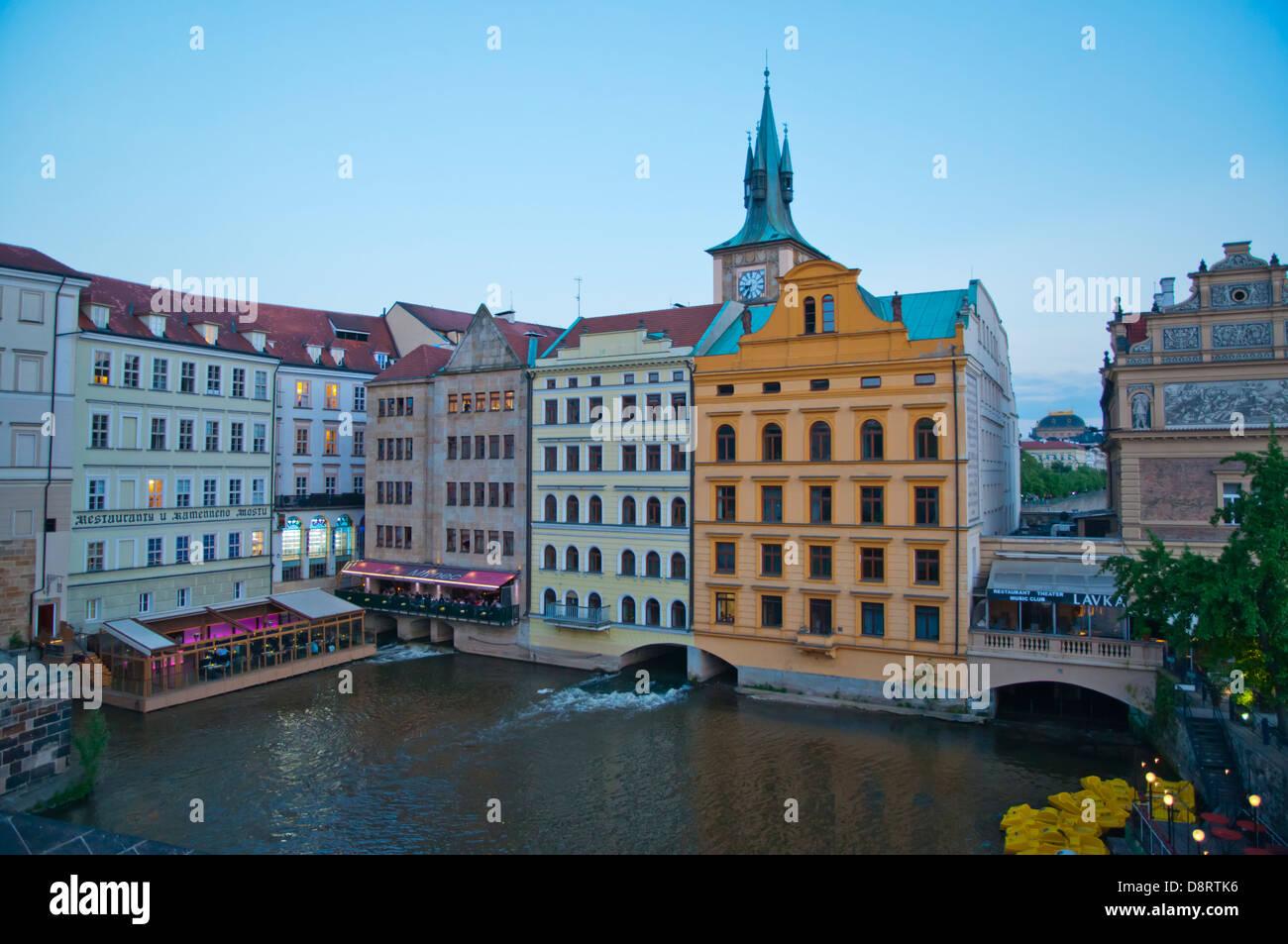 Buildings and restaurant terraces at Novotneho Lavka by river Vltavaold town Prague city Czech Republic Europe - Stock Image