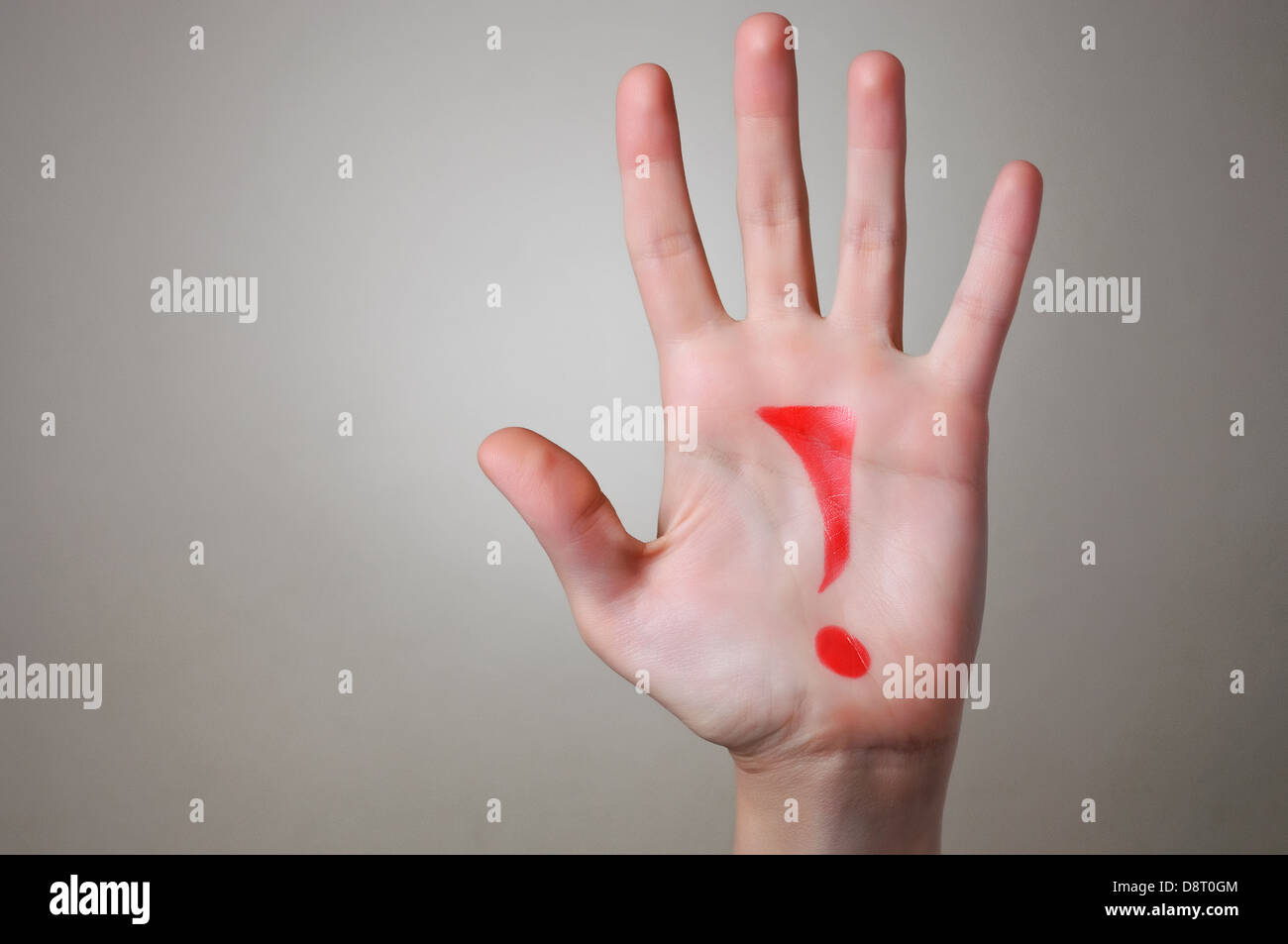 Red Exclamation Mark on a Hand - Stock Image