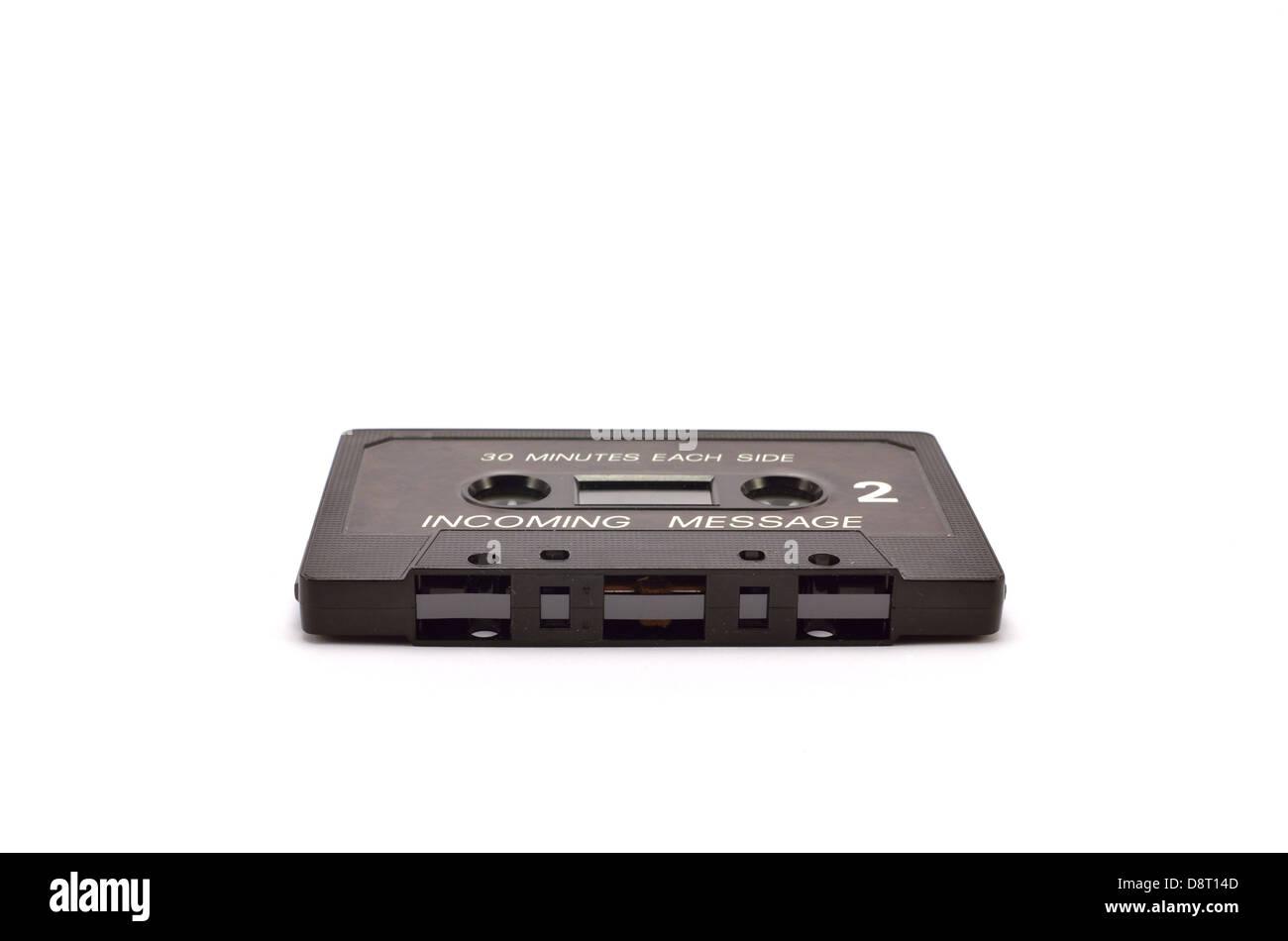 black cassette horizontally on a white background - Stock Image