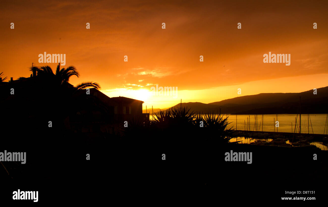 widescreen sunset in corsica - Stock Image