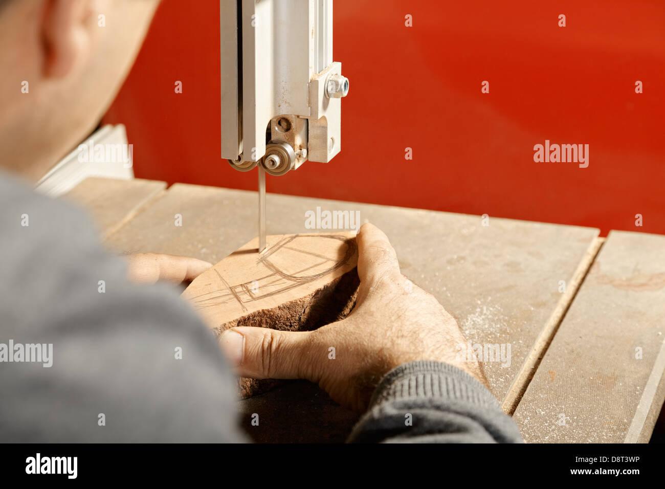 Artisan sawing billet - Stock Image