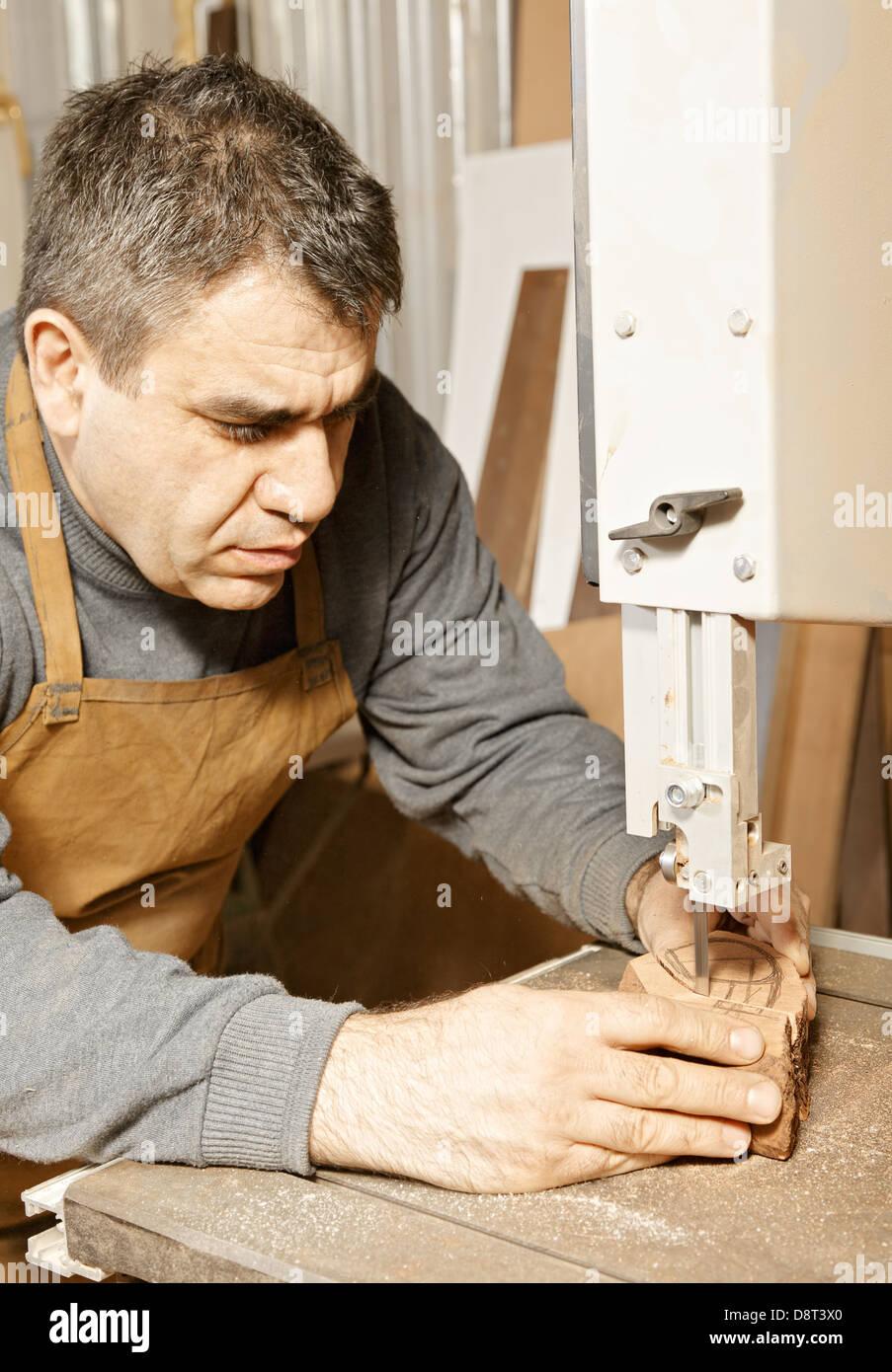 Craftsman sawing billet - Stock Image