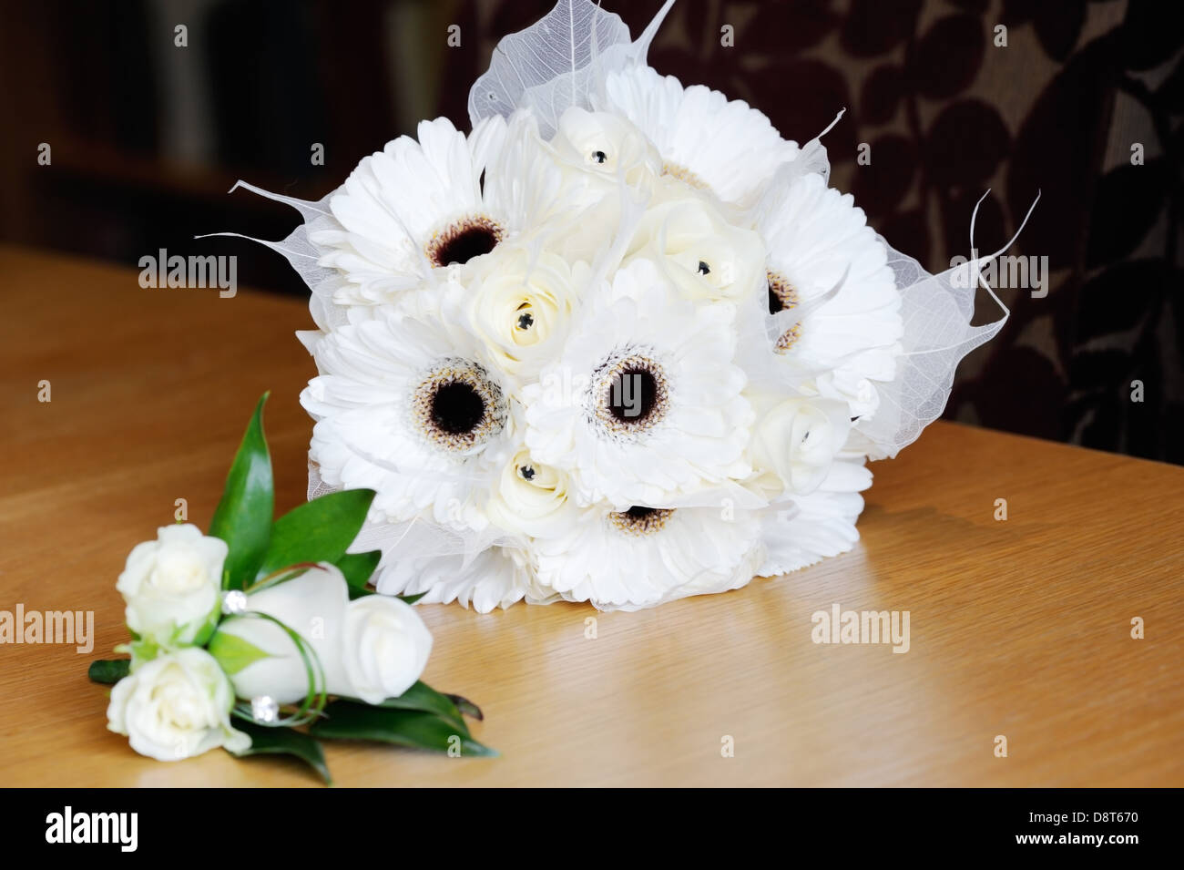 Brides Bunch Of White Flowers And Mothers Corsage Is White Rose On