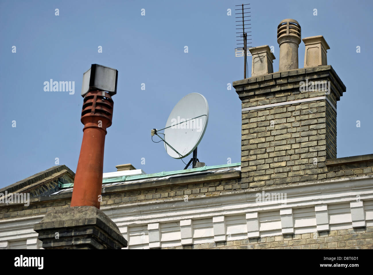 victorian rooftop with additions of chimney cowls, tv aerial and satellite dish, wimbledon, southwest london, england - Stock Image