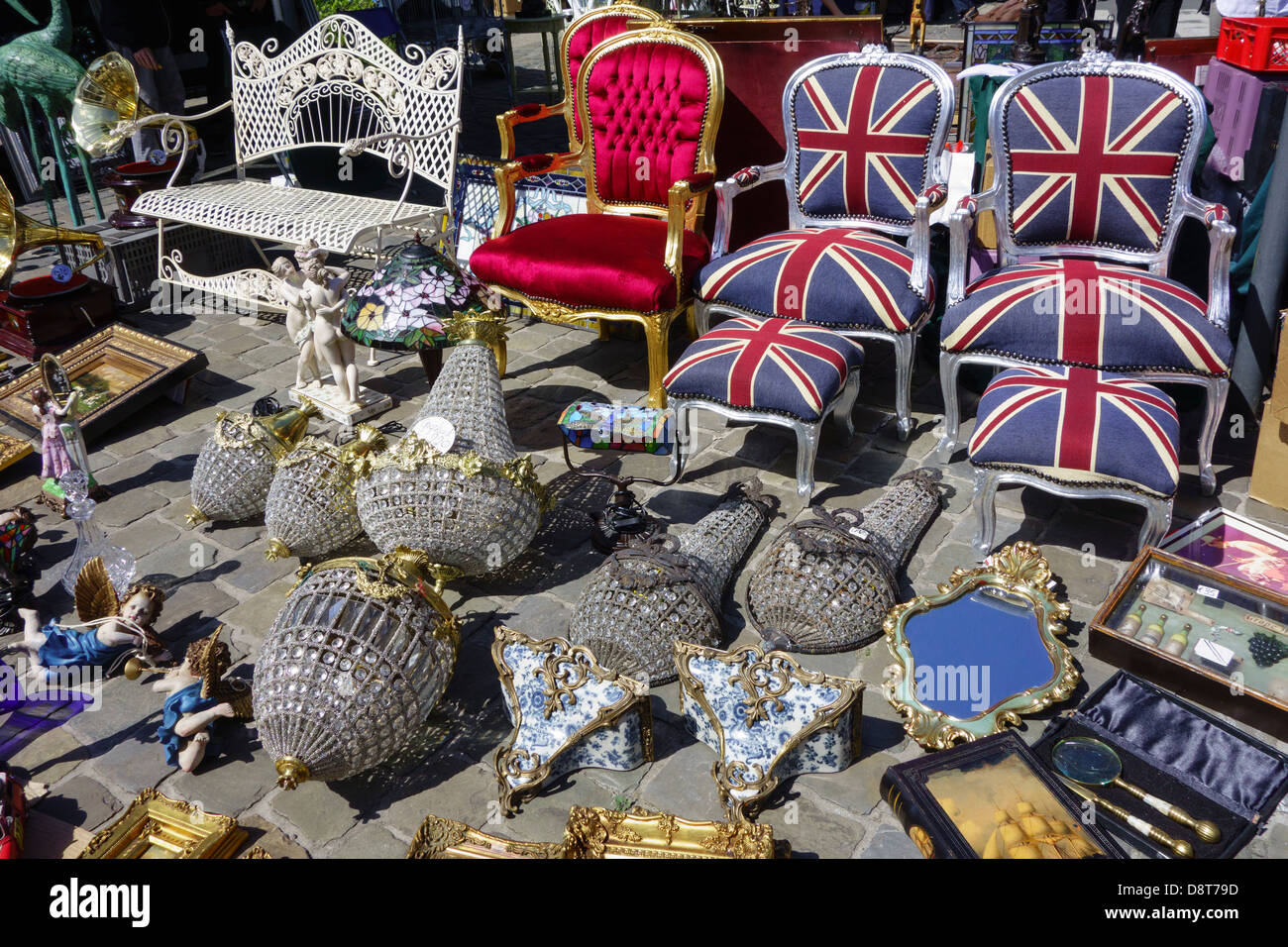 British chairs, bric-a-brac, antiques and secondhand used goods for sale at flea market in town in summer - Stock Image