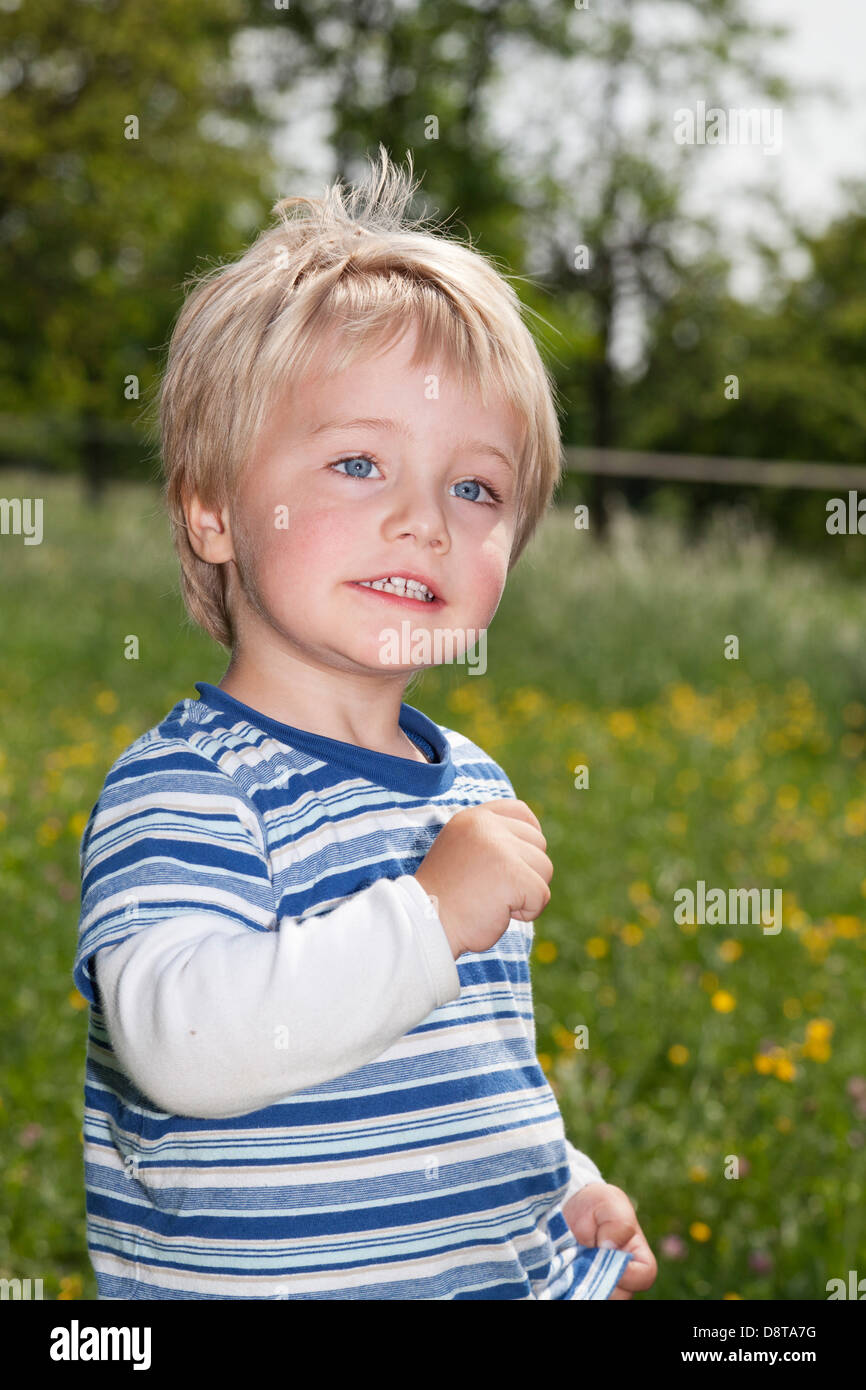 Three year-old boy with a powerful expression - Stock Image