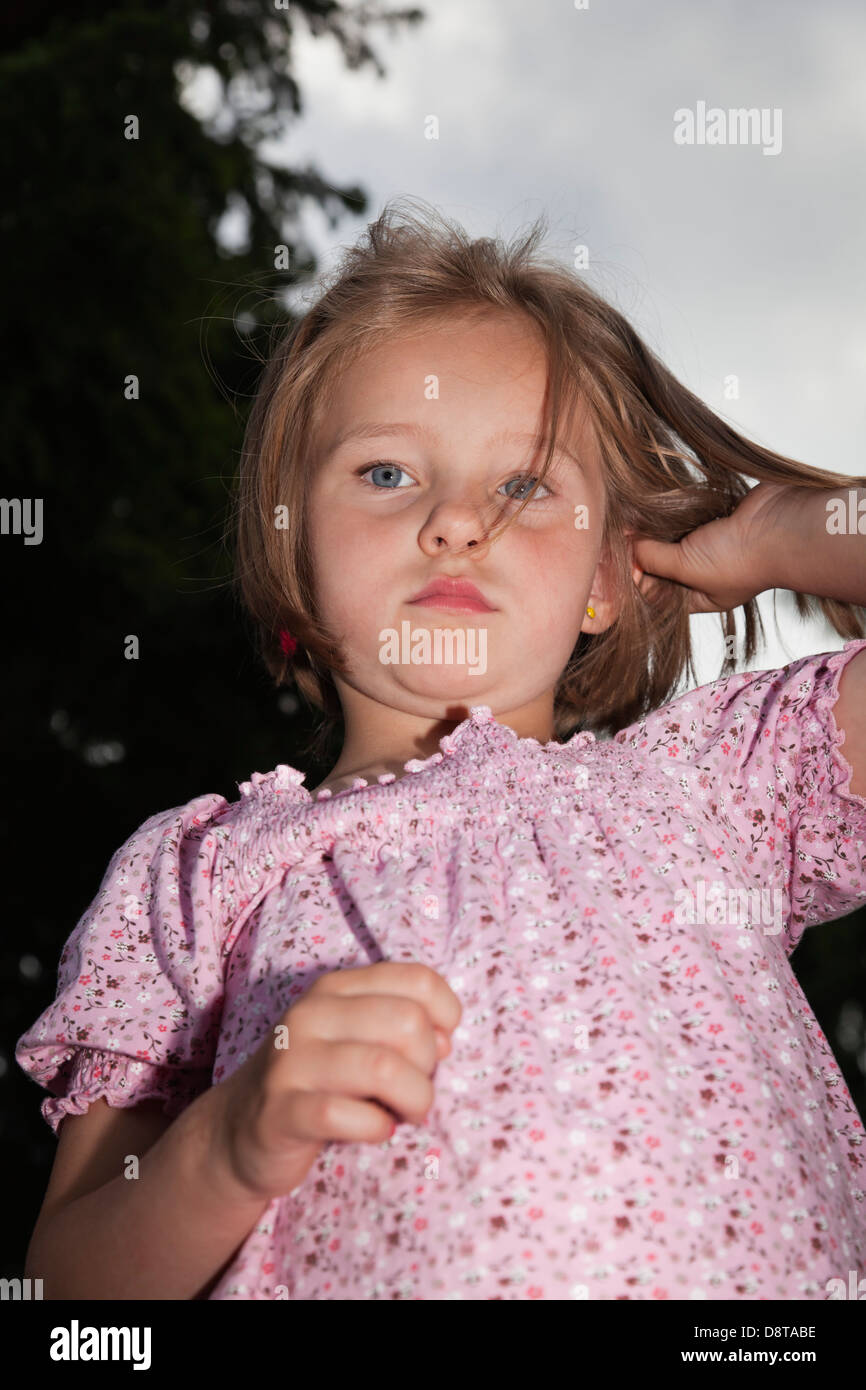 For year-old girl with a sad expression - Stock Image