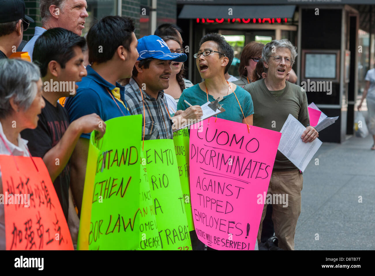 Minimum wage workers and their supporters rally to raise the minimum wage Stock Photo