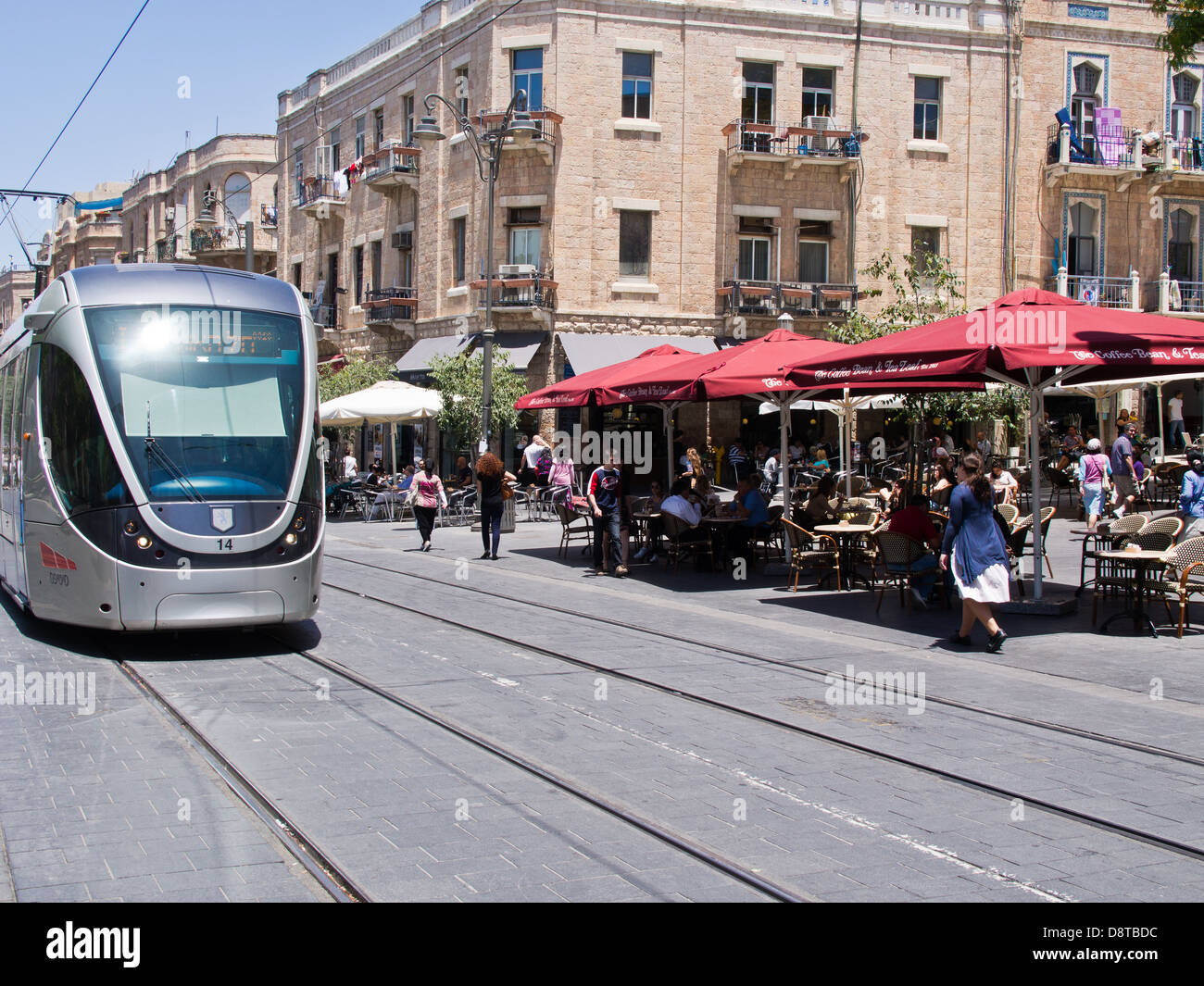 Outdoor cafes line the Light Rail Transit tracks on the renewed Jaffa Road in downtown Jerusalem - Stock Image