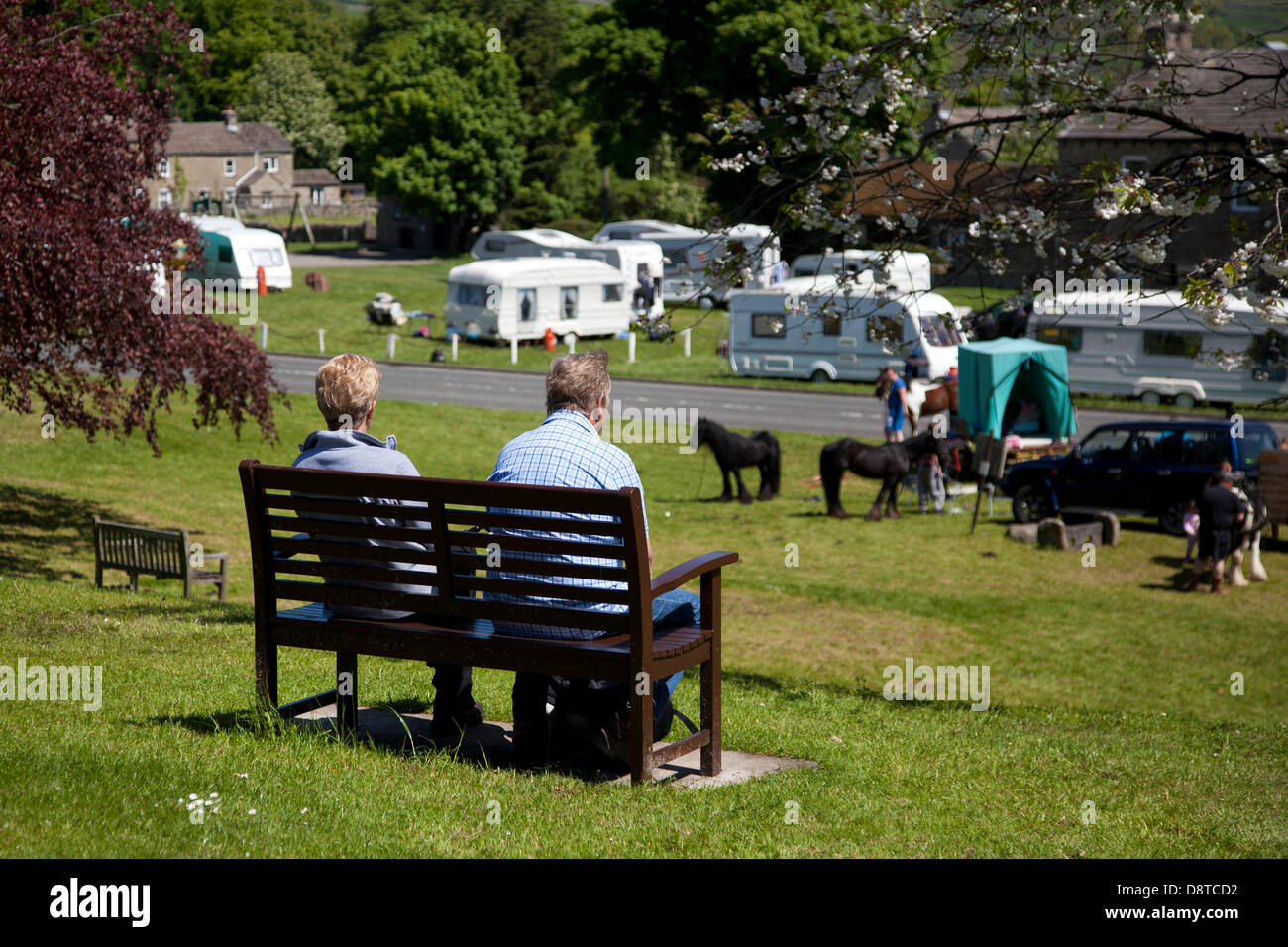 Trailer homes at Bainbridge, Richmondshire, North Yorkshire, UK. 4th June, 2013. Local Residents observing the encampment - Stock Image