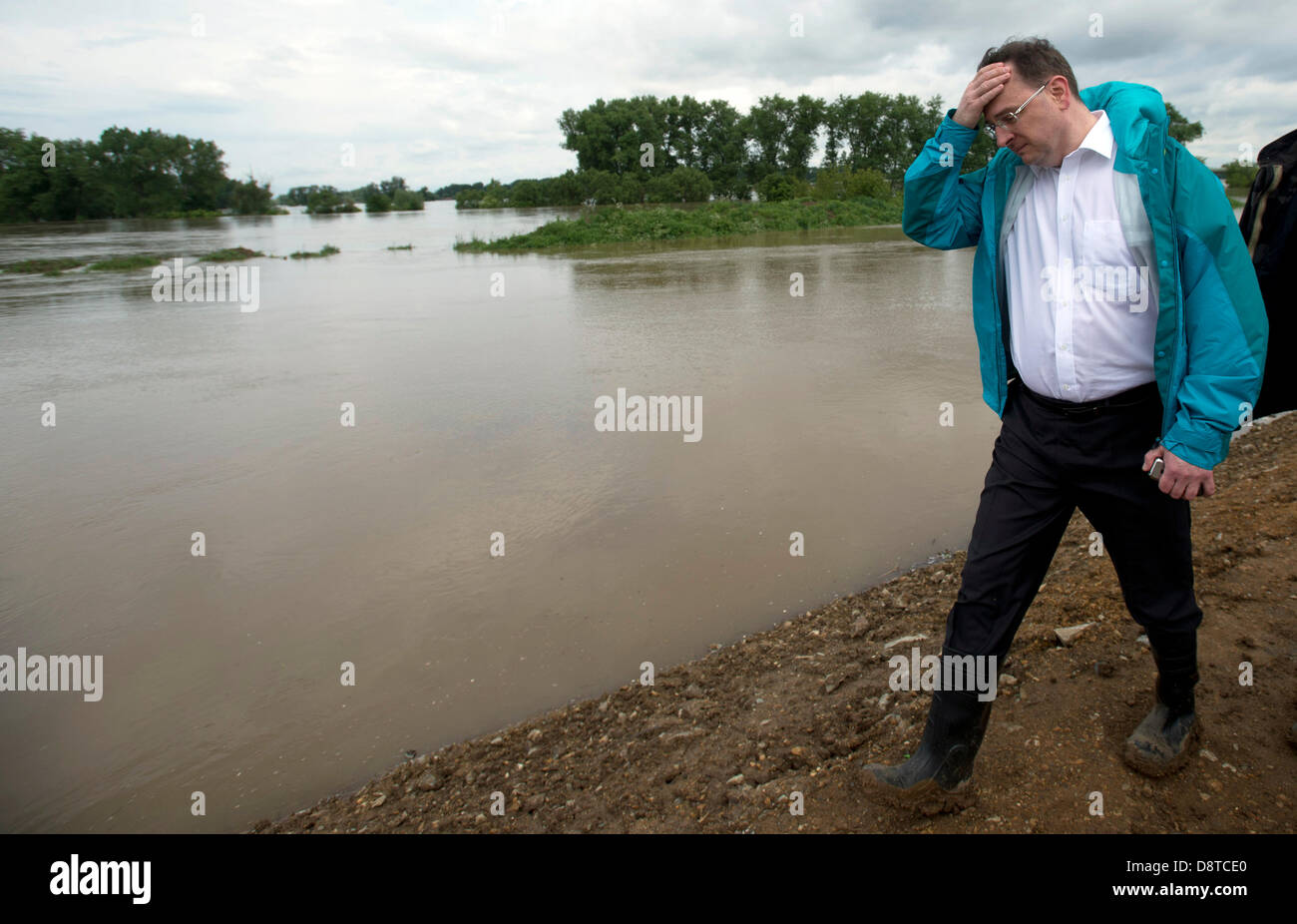 Czech Prime Minister Petr Necas Holds His Head As He Inspects The