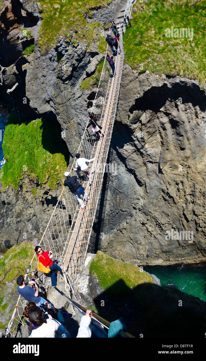 Carrick-a-Rede Island with rope bridge and tourists CarrickaRede - Stock Image