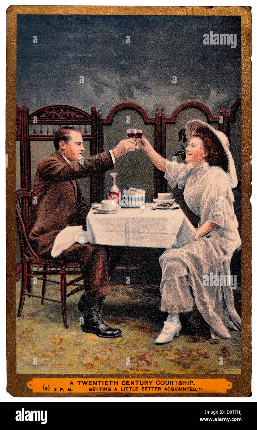 Couple in Restaurant Toasting Each Other With Wine Glasses, 'A Twentieth Century Courtship', Circa 1901 - Stock Image