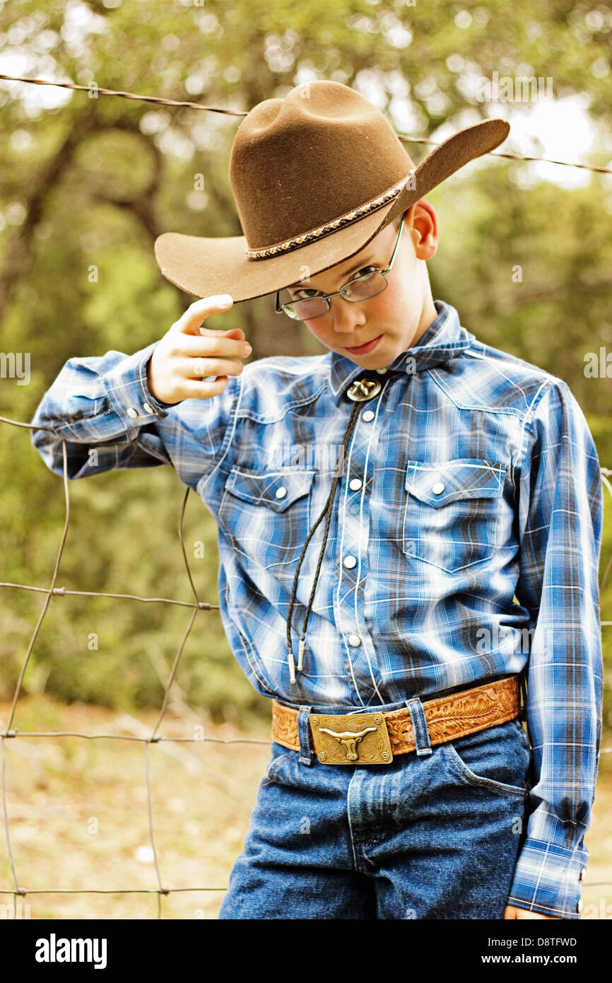 young cowboy wearing glass  tipping his hat Blanco, TX / tx / Texas - Stock Image