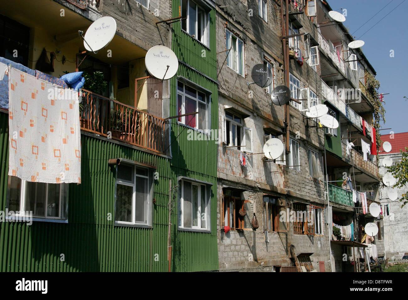 Satellite dishes on the multistory building in Batumi, Georgia, Caucasus region - Stock Image