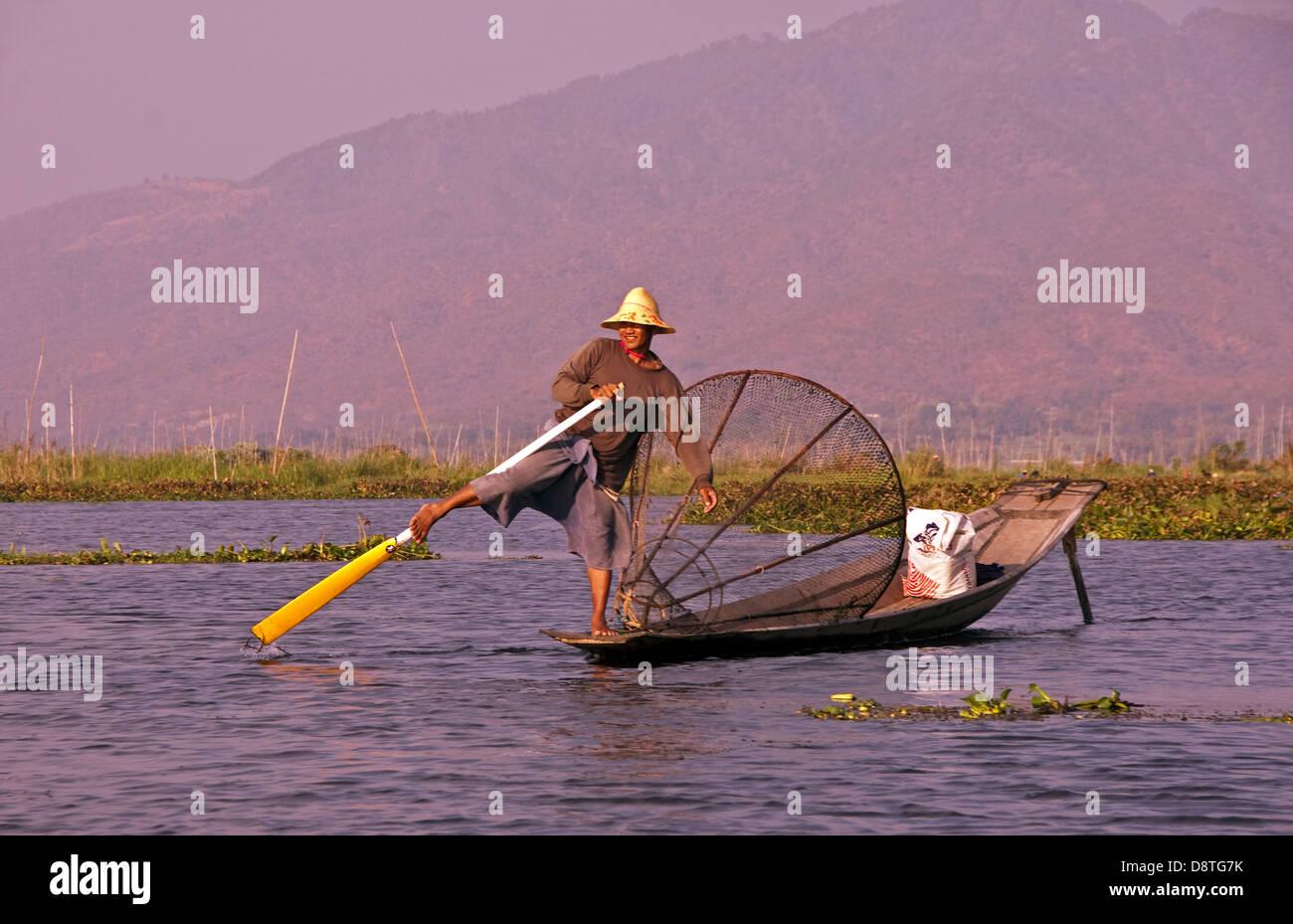 Lake Inle leg-rower with fishing net, Shan State, Myanmar - Stock Image