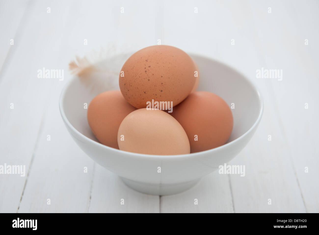 Freshly laid organic free range eggs in a bowl. - Stock Image