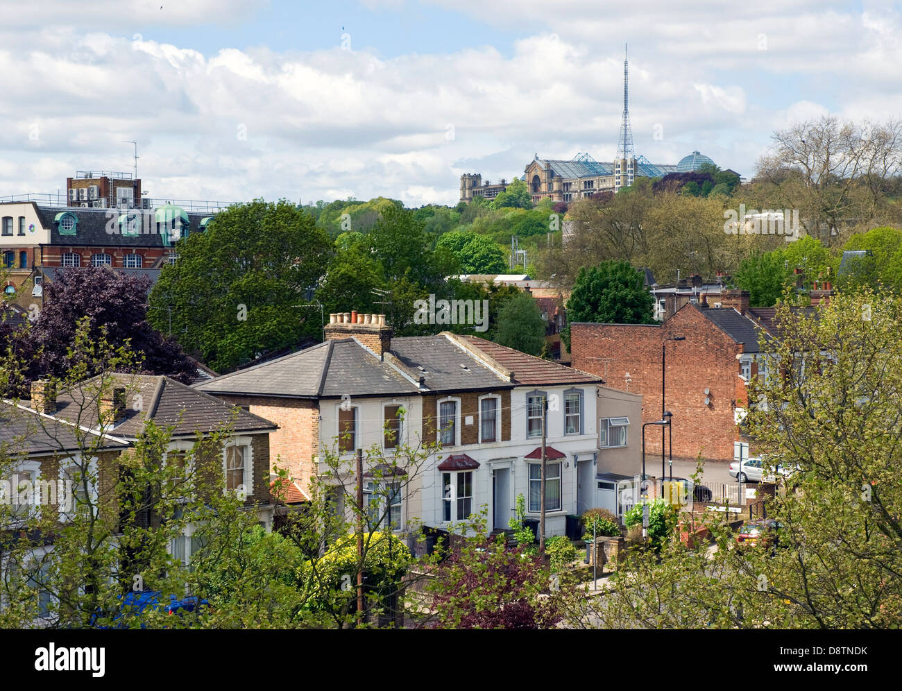 The famous Alexandra Palace looks down over houses in Wood Green, a suburb in Haringey, north London - Stock Image
