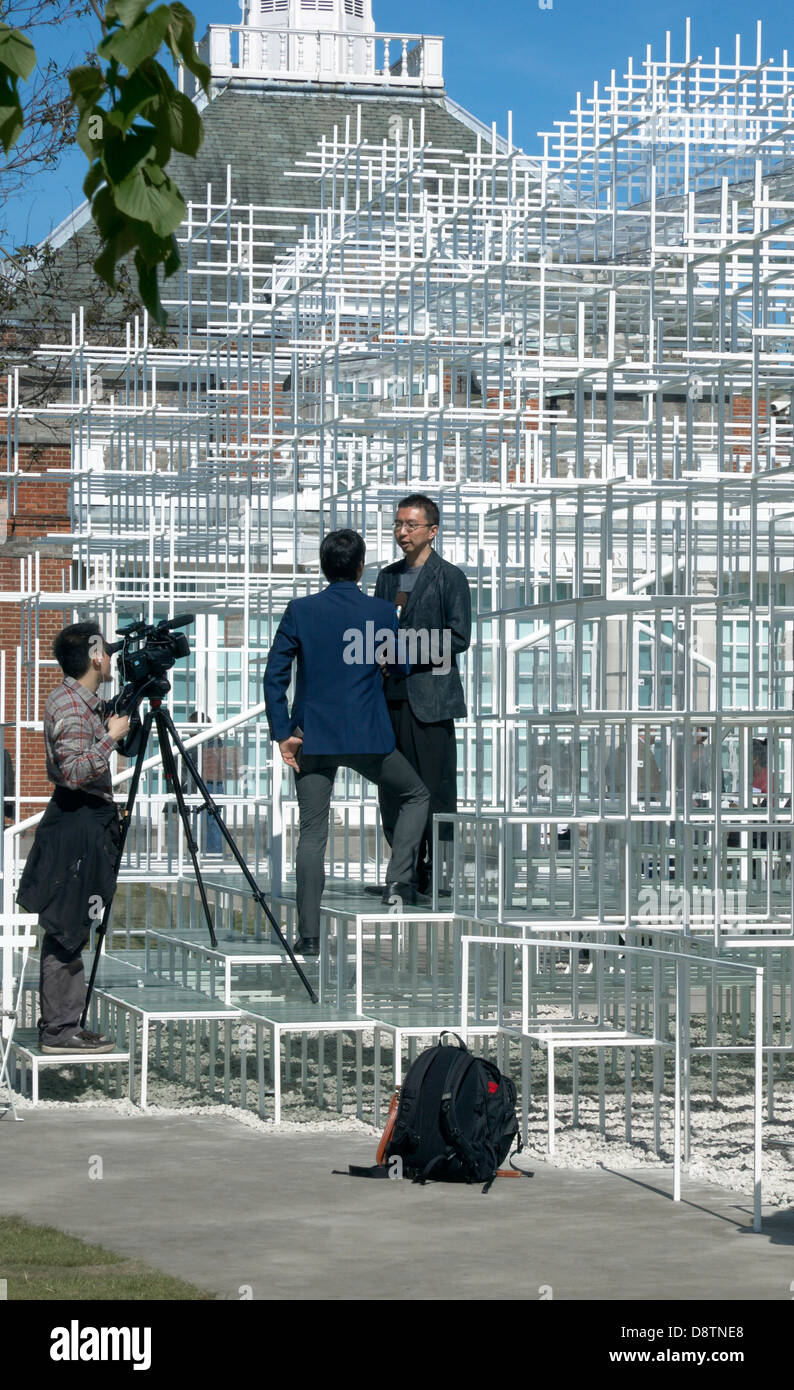 Japanese Architect Sou Fujimoto being interviewed by his newly designed 2013 Serpentine Summer Pavilion, London, - Stock Image