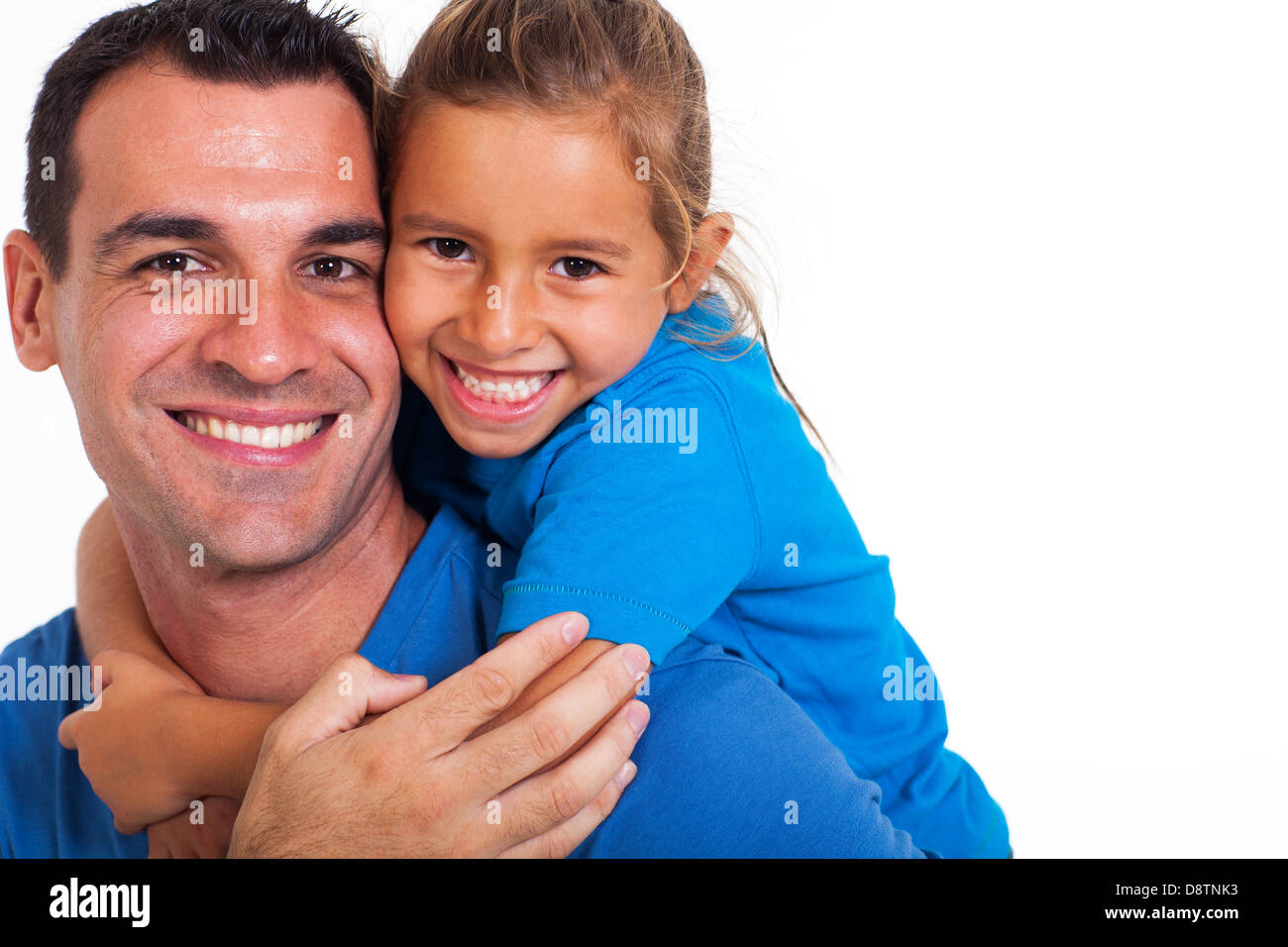 joyful father giving piggyback ride to his daughter against a white background - Stock Image