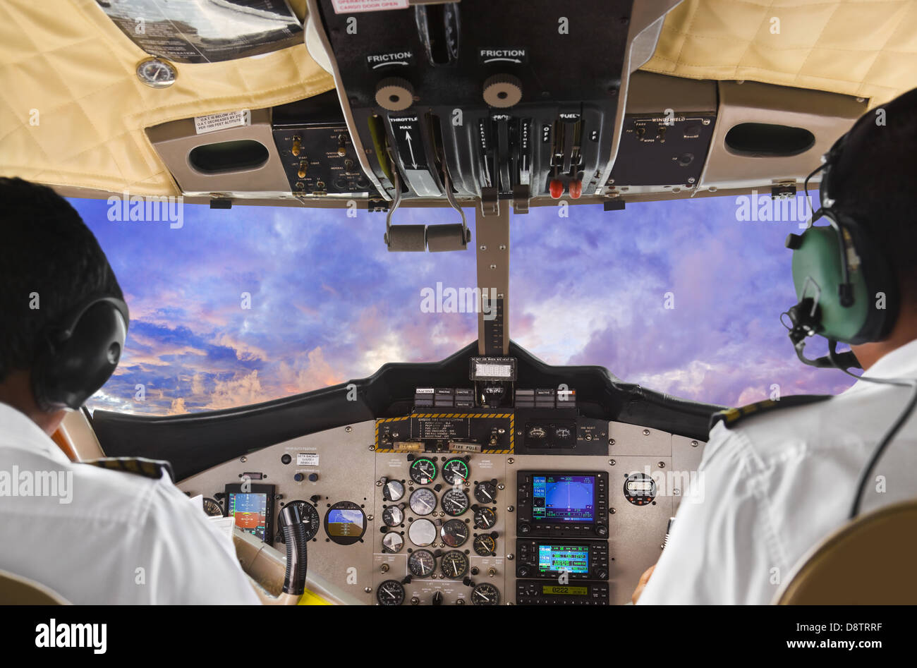 Pilots in the plane cockpit and sunset - Stock Image