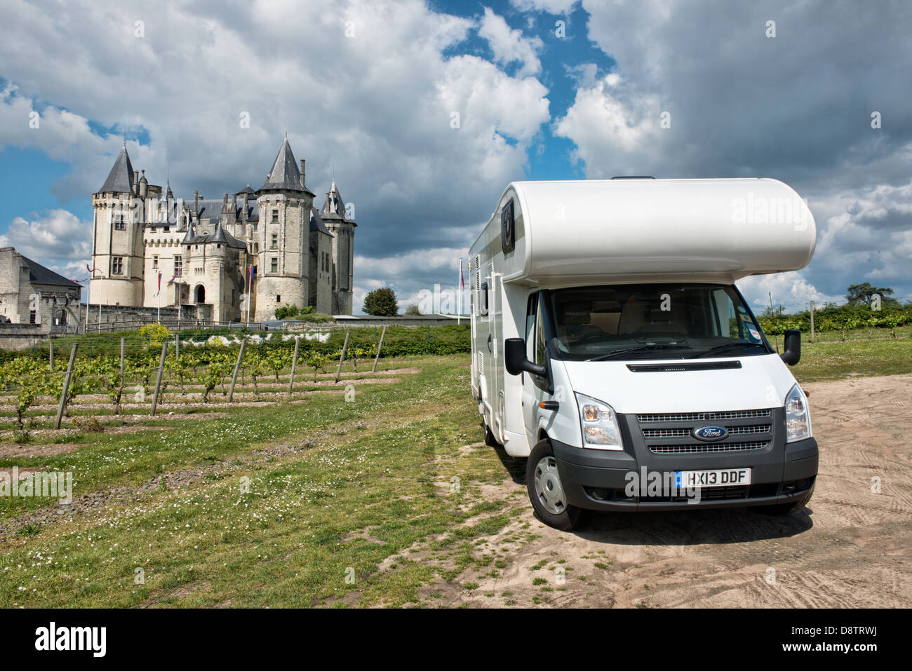 A Ford  Transit motorhome parked by the vinevards in front of the historic Château de Saumur in the Loire valley, - Stock Image