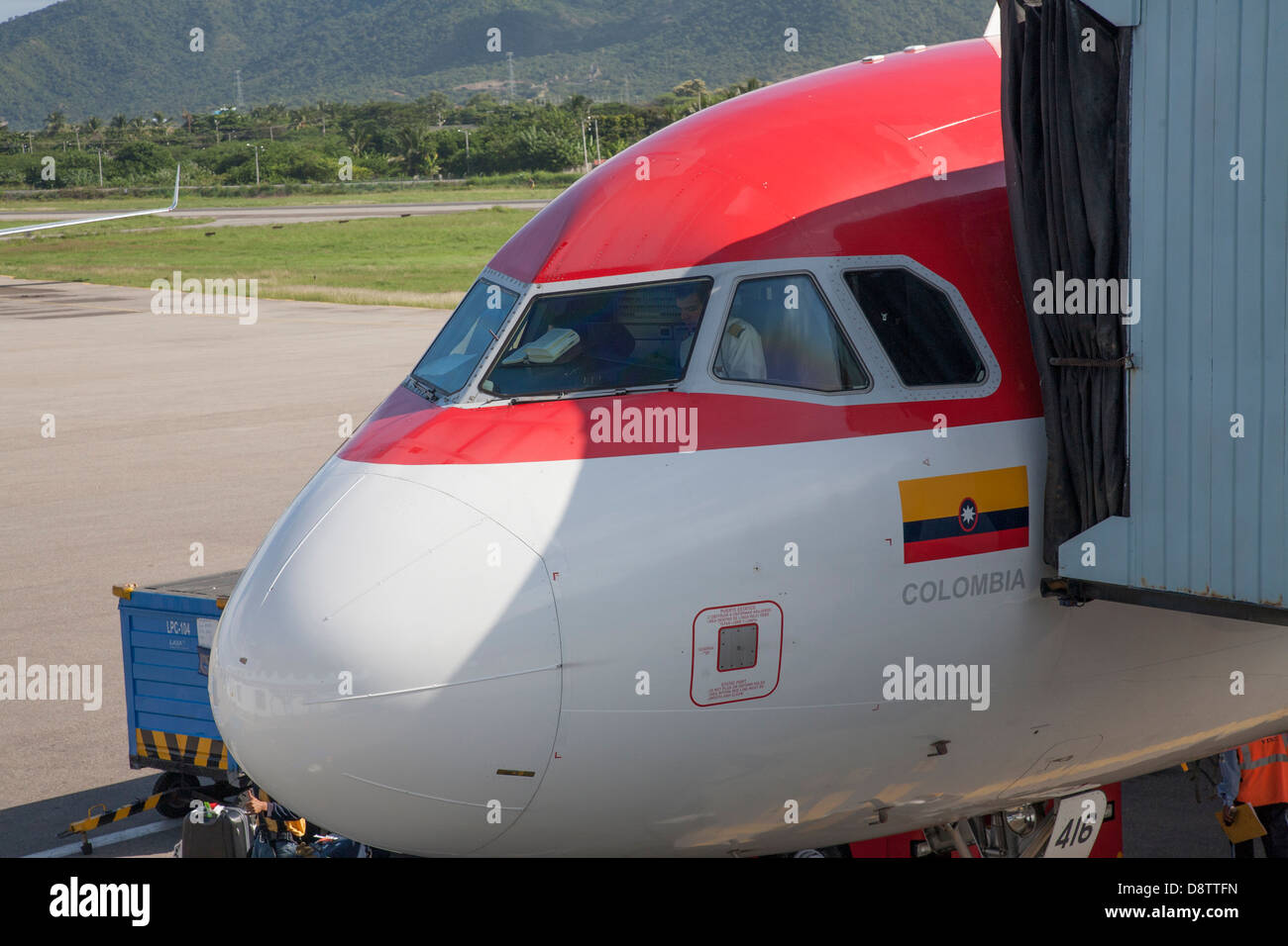 Avianca Airlines Plane Taxiing at Santa Marta Airport, Colombia - Stock Image