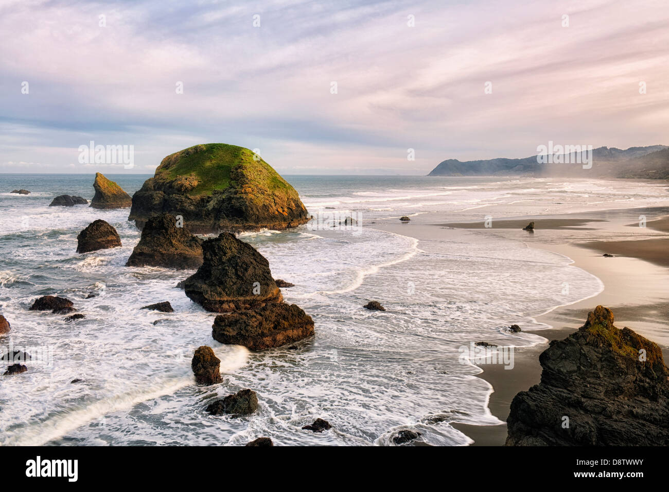 First light on the many offshore sea stacks at Crook Point on Oregon's south coastline in Curry County. - Stock Image
