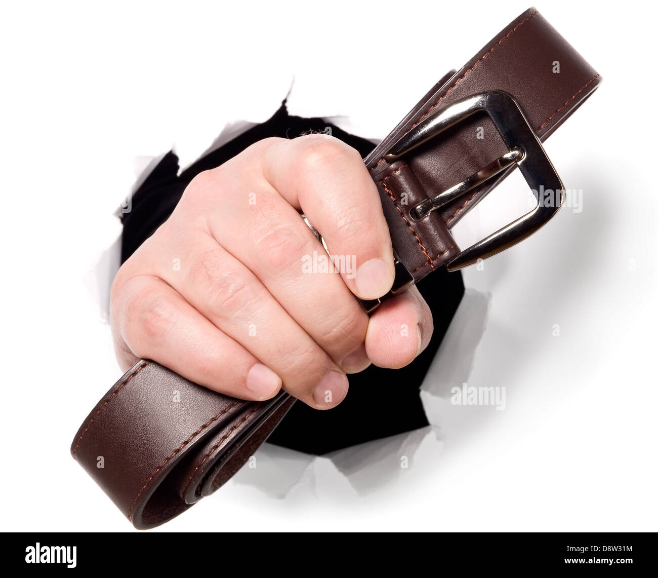 Man is holding belt through a hole in white paper - Stock Image