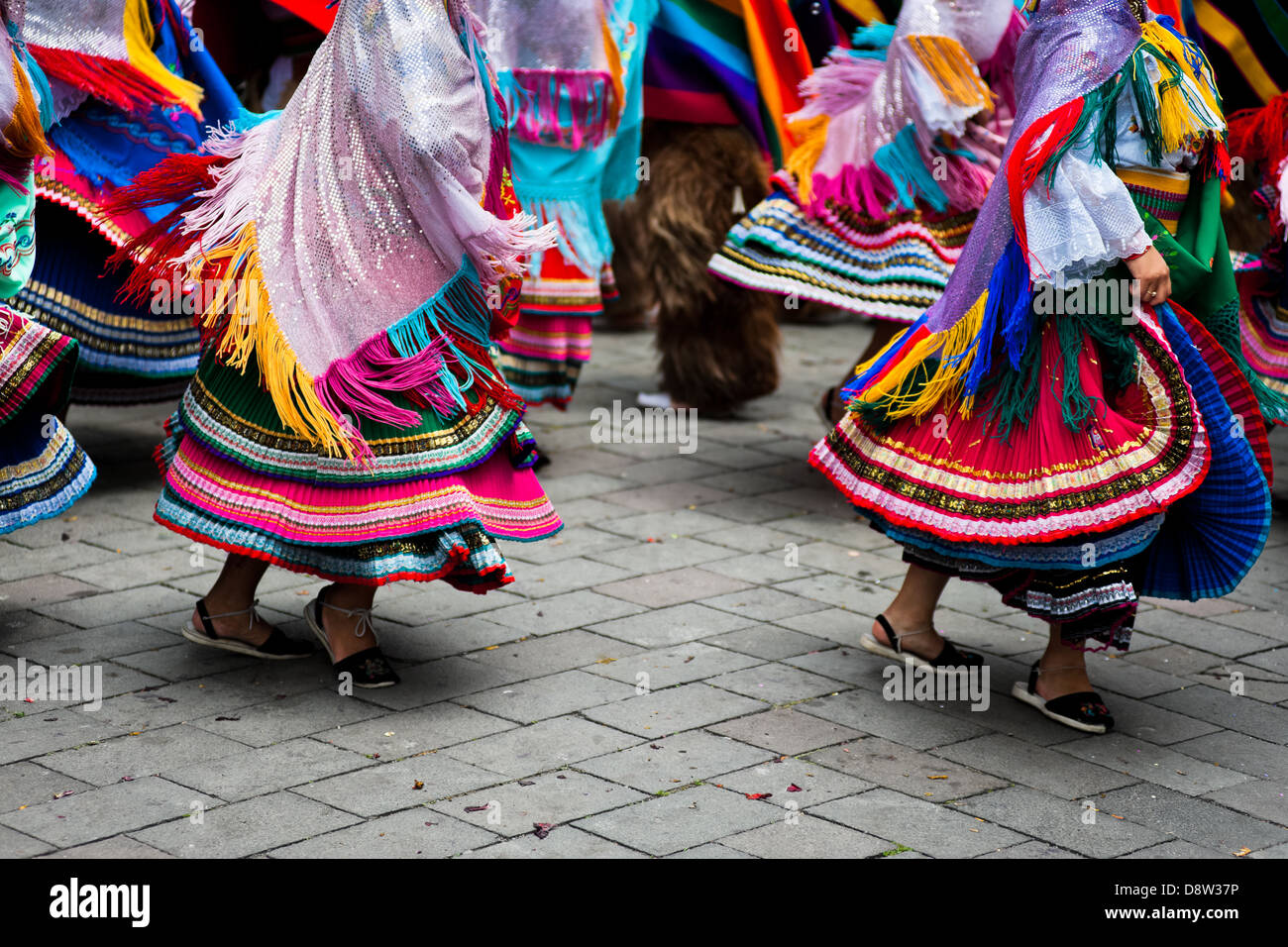 Woman dancers (danzantes) perform in the religious parade within the Corpus Christi festival in Pujilí, Ecuador. - Stock Image