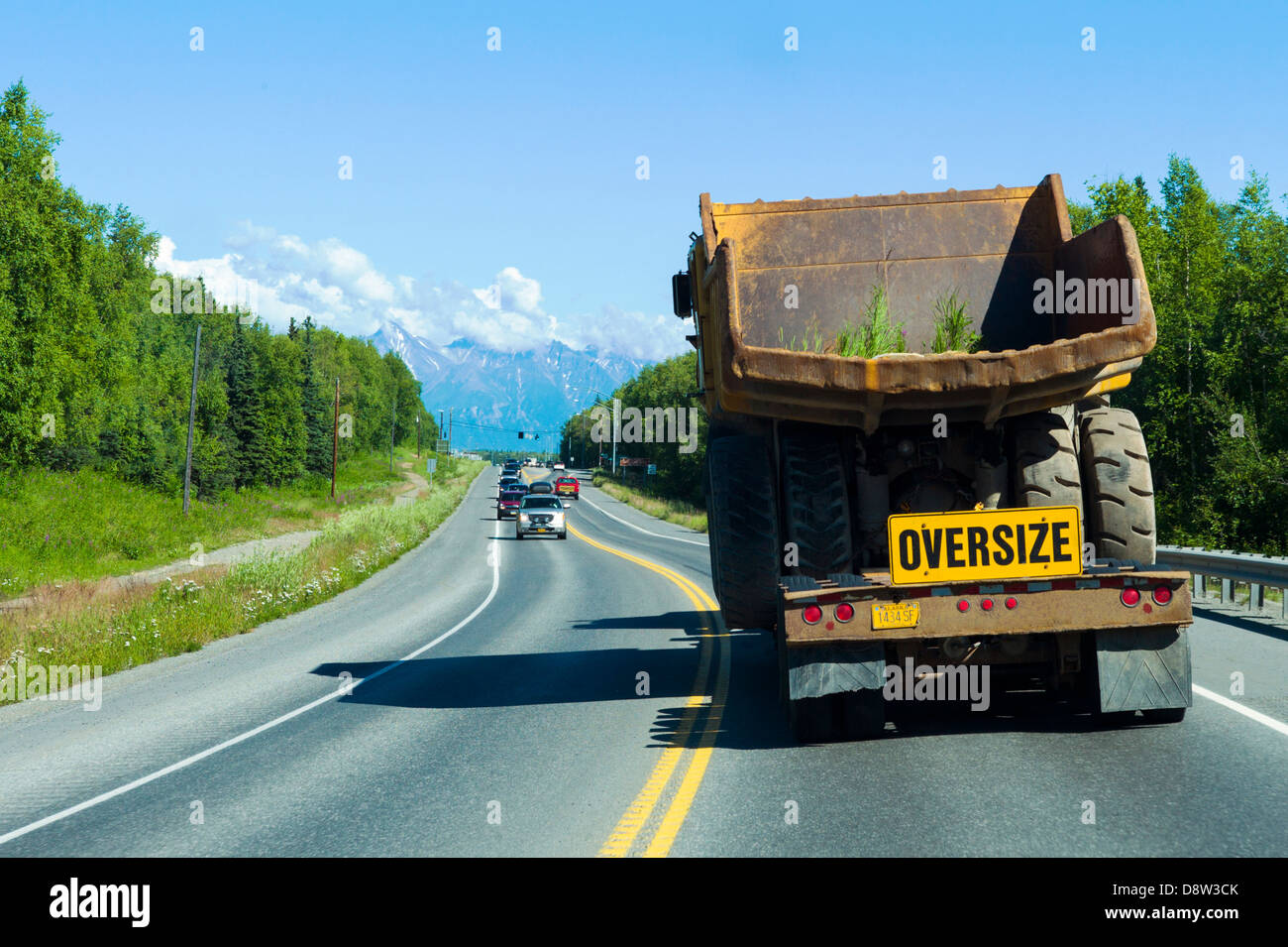 Construction vehicle, oversize, wide load, traveling south on Highway 3, north of Anchorage, Alaska, USA Stock Photo