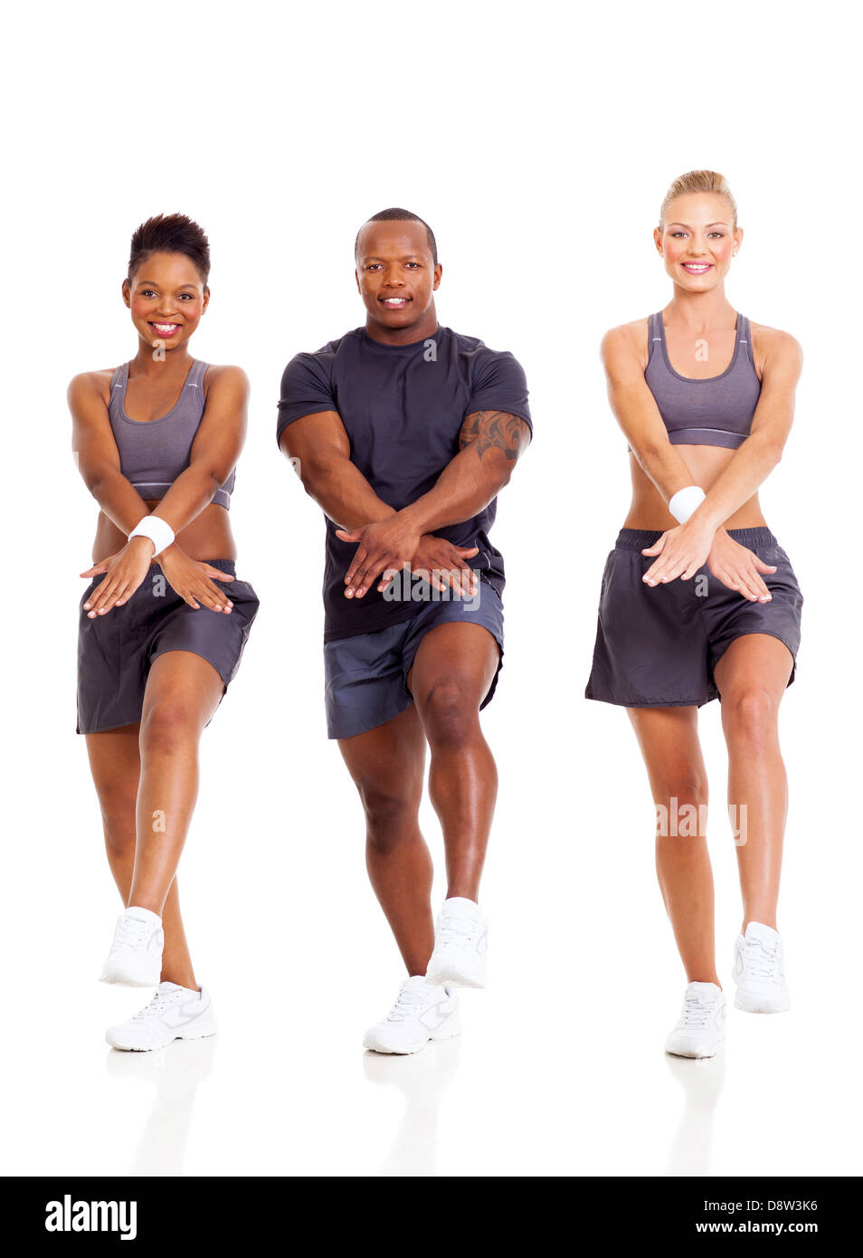 group of fit people working out on white background - Stock Image