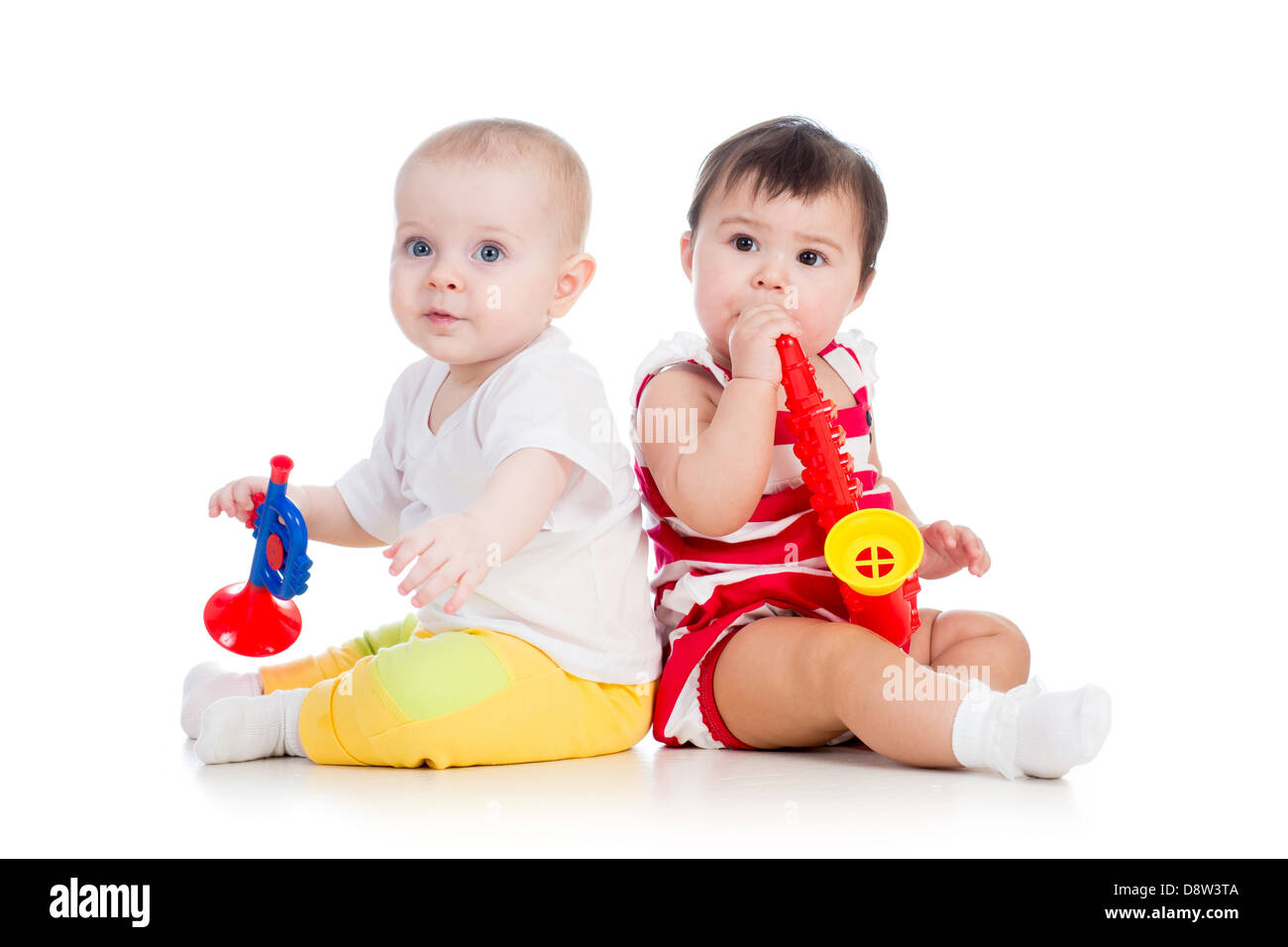 kids girls playing with musical toy - Stock Image
